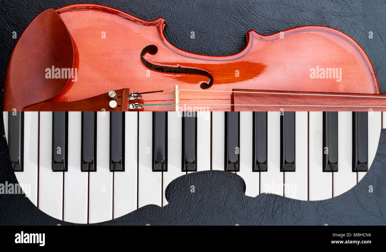 Piano Keys In To The Violin On Black Leather Table Half Keyboard Like