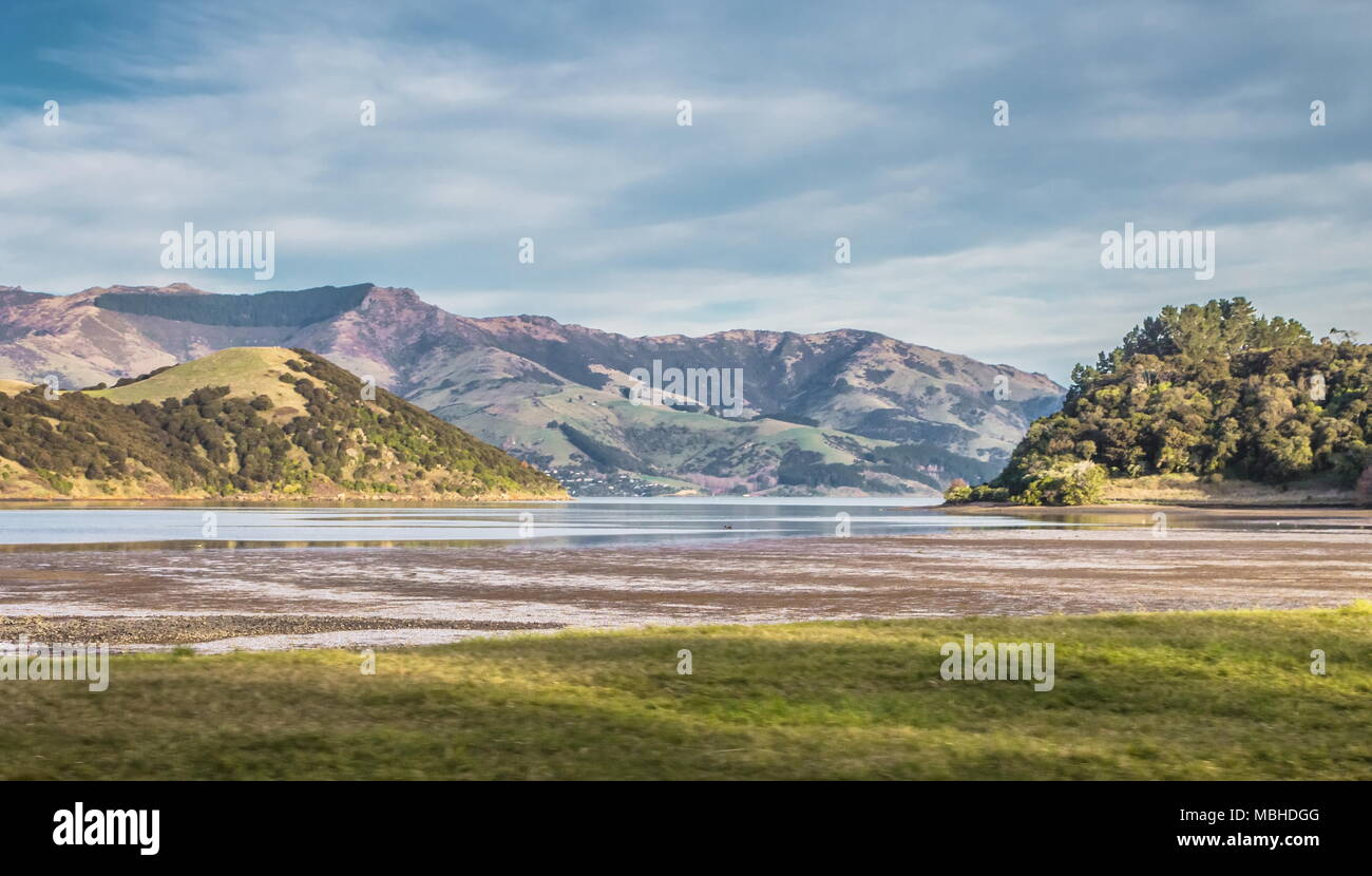 Scenic View of Akaroa Harbour at low tide. Akaroa Harbour is part of the  Banks Peninsula in the Canterbury Region of New Zealand. - Stock Image