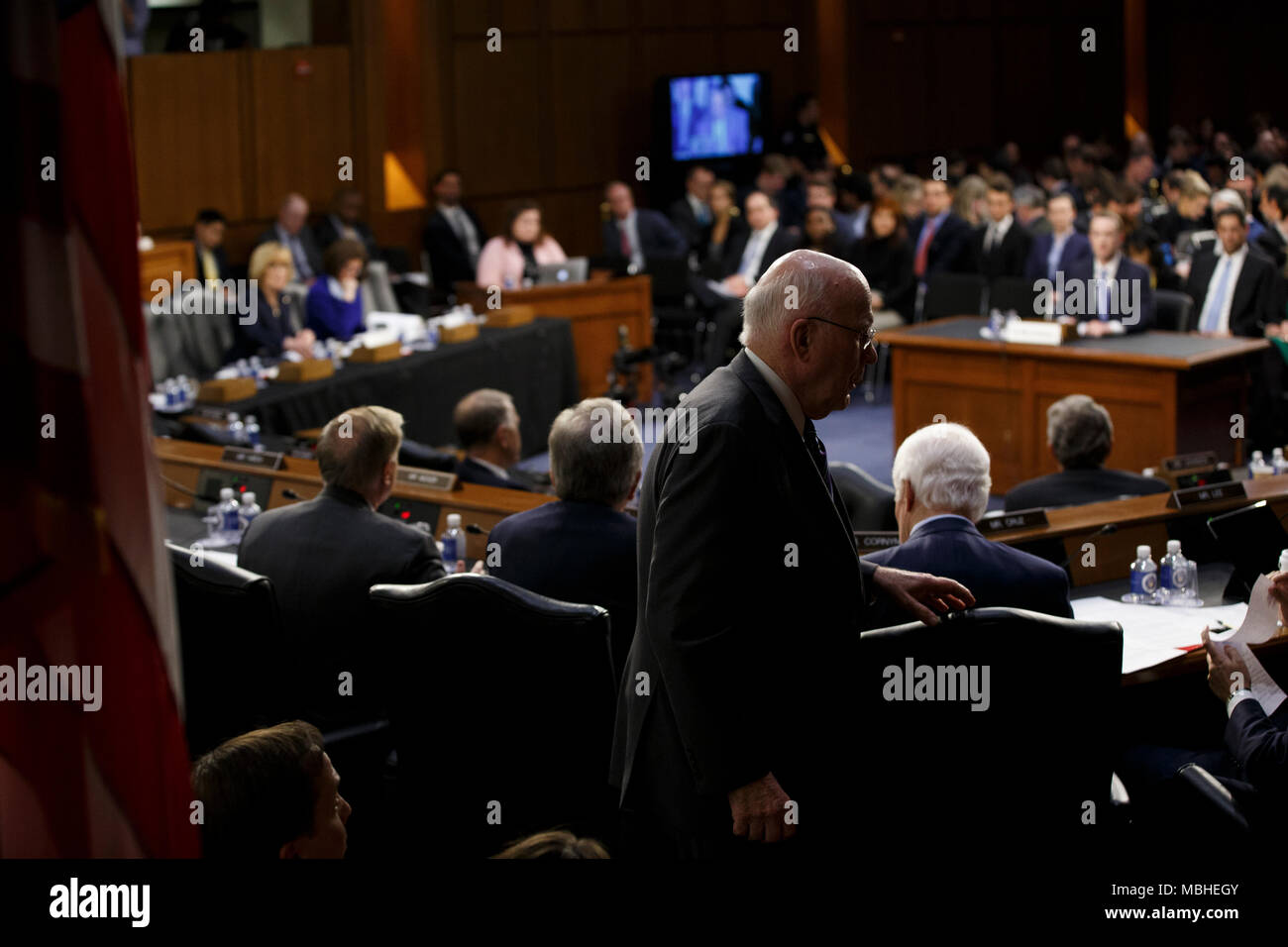 Washington, USA. 10th Apr, 2018. Senator Patrick Leahy, Democrat of Vermont, walks behind the dais as Facebook CEO Mark Zuckerberg testifies before the United States Senate on Capitol Hill in Washington, DC on April 10, 2018. Credit: The Photo Access/Alamy Live News Stock Photo
