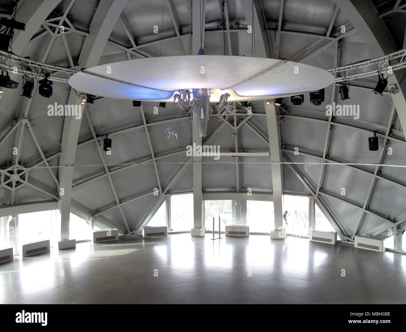 26 January 2018, Belgium, Brussels: The lamp 'Friendly Intrusion from Outer Space' by Ingo Maurer hangs inside one of the spheres that make up the 102m tall Atomium building. The Atomium was created for the World Exhibtion of 1958 and celebrates its 60th anniversary on 17 April 2018. Photo: Elena Metz/dpa - Stock Image