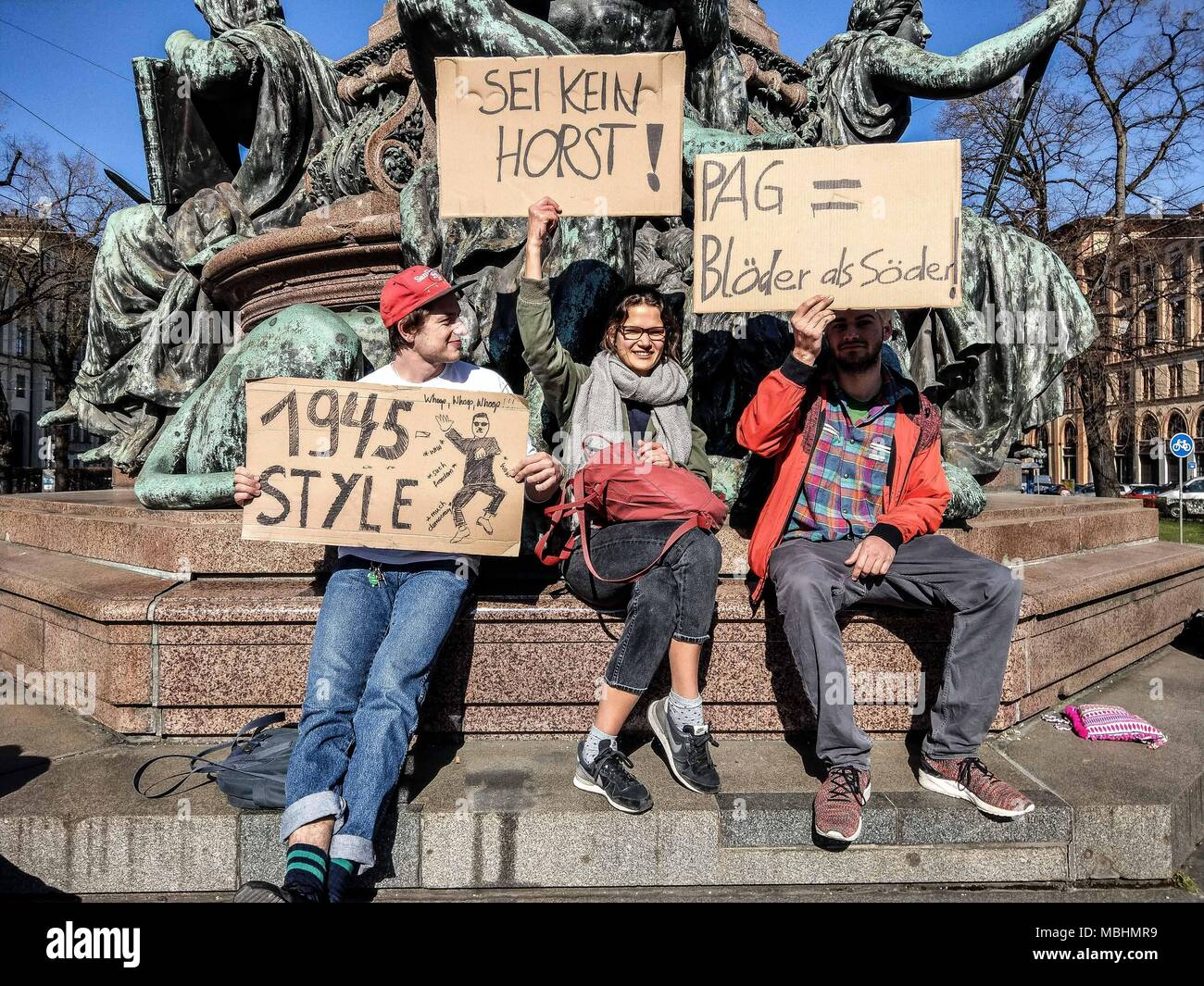 Munich, Bavaria, Germany. 11th Apr, 2018. Lilith (22) and Mariella (22), both students that worry about being put under general suspicion due to political and antifascist engagement. The Green Party Youth (Gruene Jugend) of Munich, along with 120 members of the SPD, JuSos, Mut Bayern, and die Linke demonstrated against the forthcoming Polizeiaufgabengesetze (PAG, Police Assignment Laws) that give police in Bavaria sweeping secret police-like powers that are alleged to be threats to Germany's model democracy. Credit: ZUMA Press, Inc./Alamy Live News - Stock Image