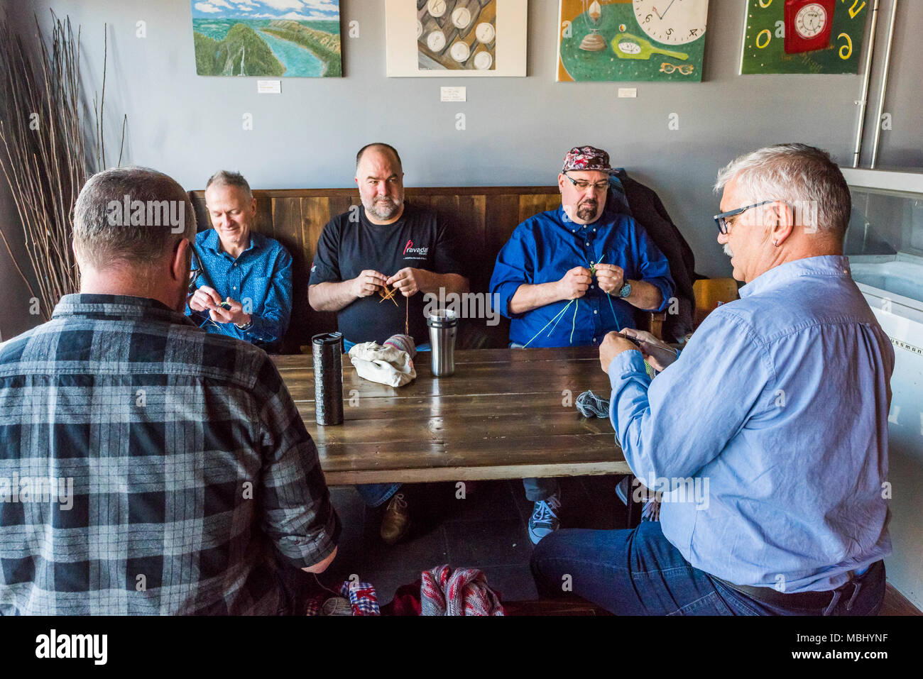 Five men knitting in an East Village Coffee Shop, Vancouver, British Columbia, Canada. - Stock Image