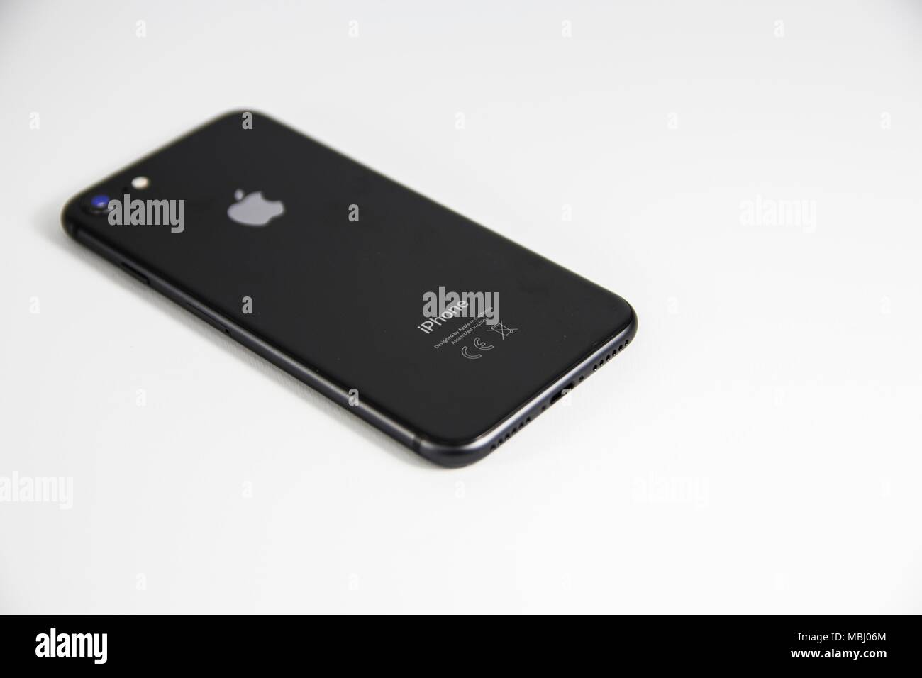 iPhone is a line of high-end smartphones designed and marketed by Apple Inc. It runs the iOS mobile operating system, known until mid-2010 as 'iPhone. - Stock Image