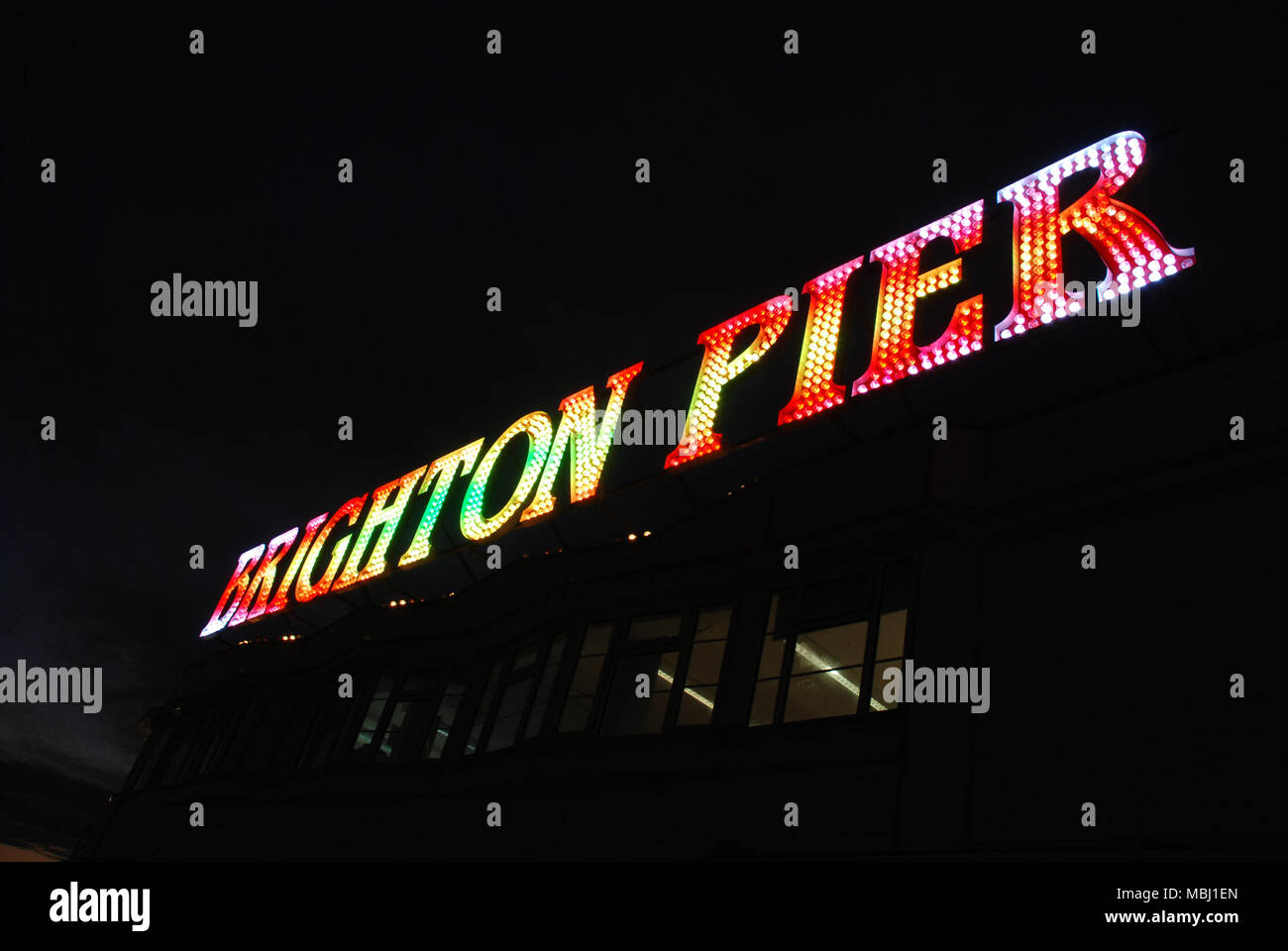 Bright Pier sign at Night - Stock Image