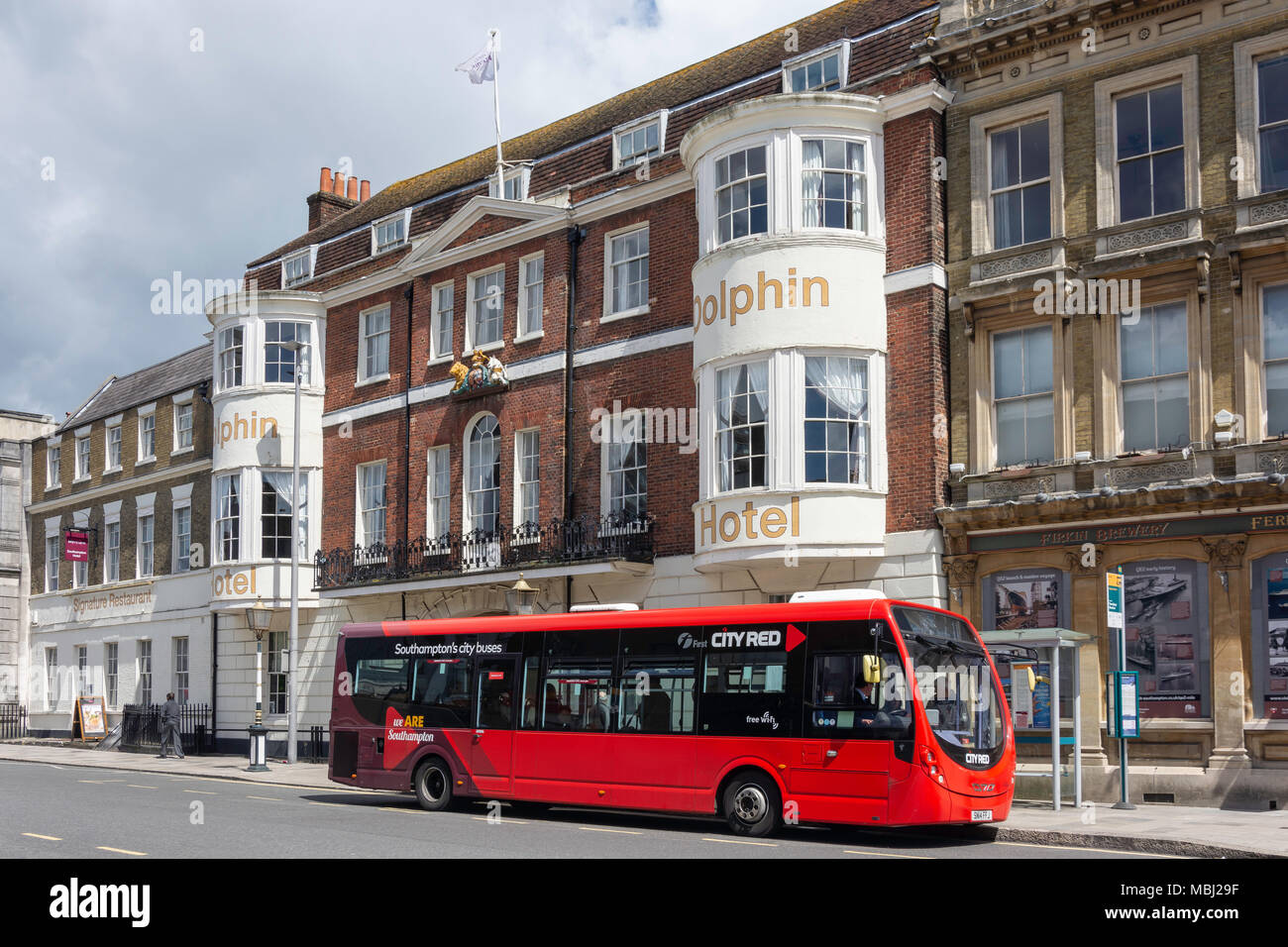First City Red bus outside The Dolphin Hotel, High Street, Southampton, Hampshire, England, United Kingdom - Stock Image