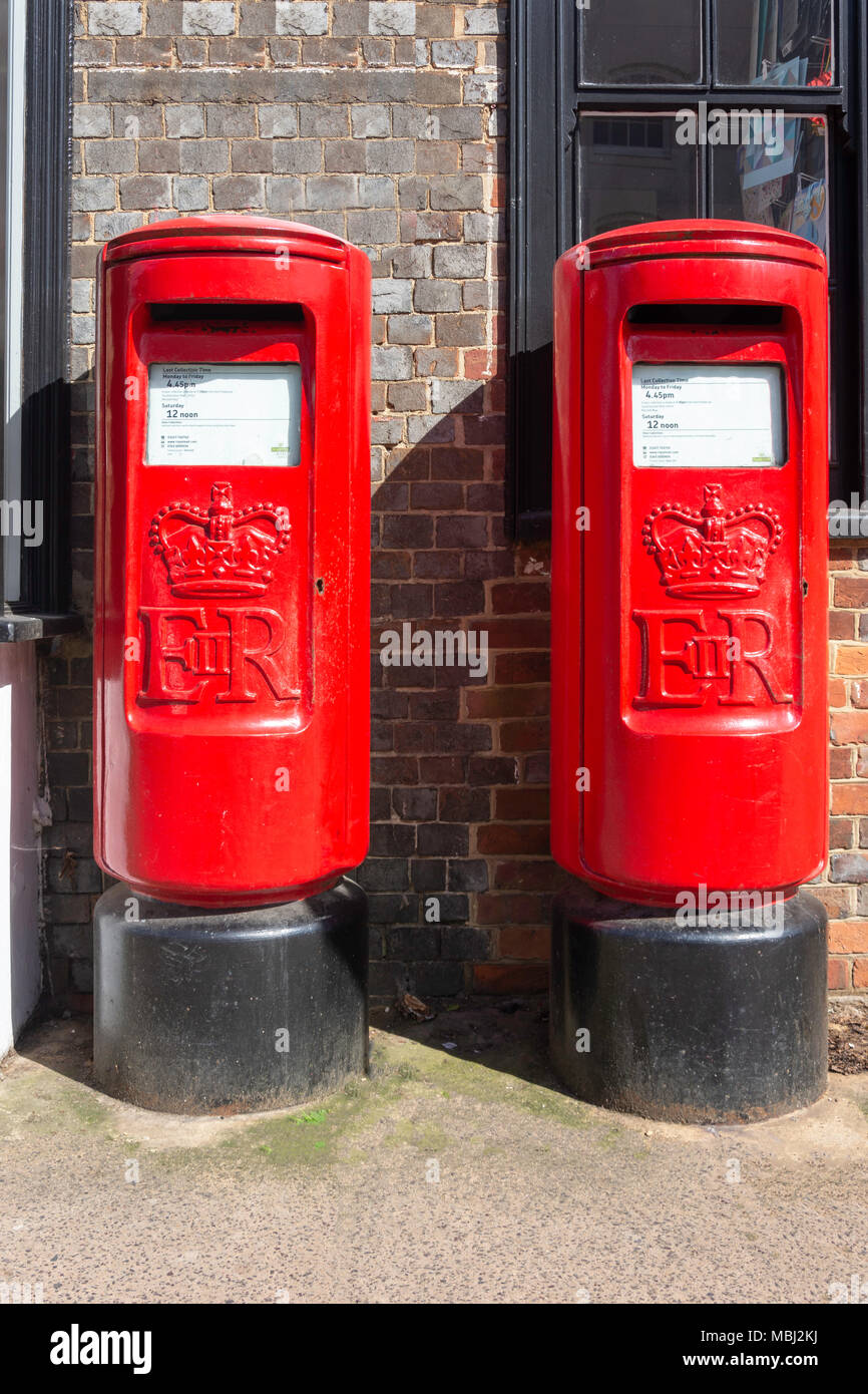 Pair of red pillar boxes on High Street, Bishop's Waltham, Hampshire, England, United Kingdom - Stock Image