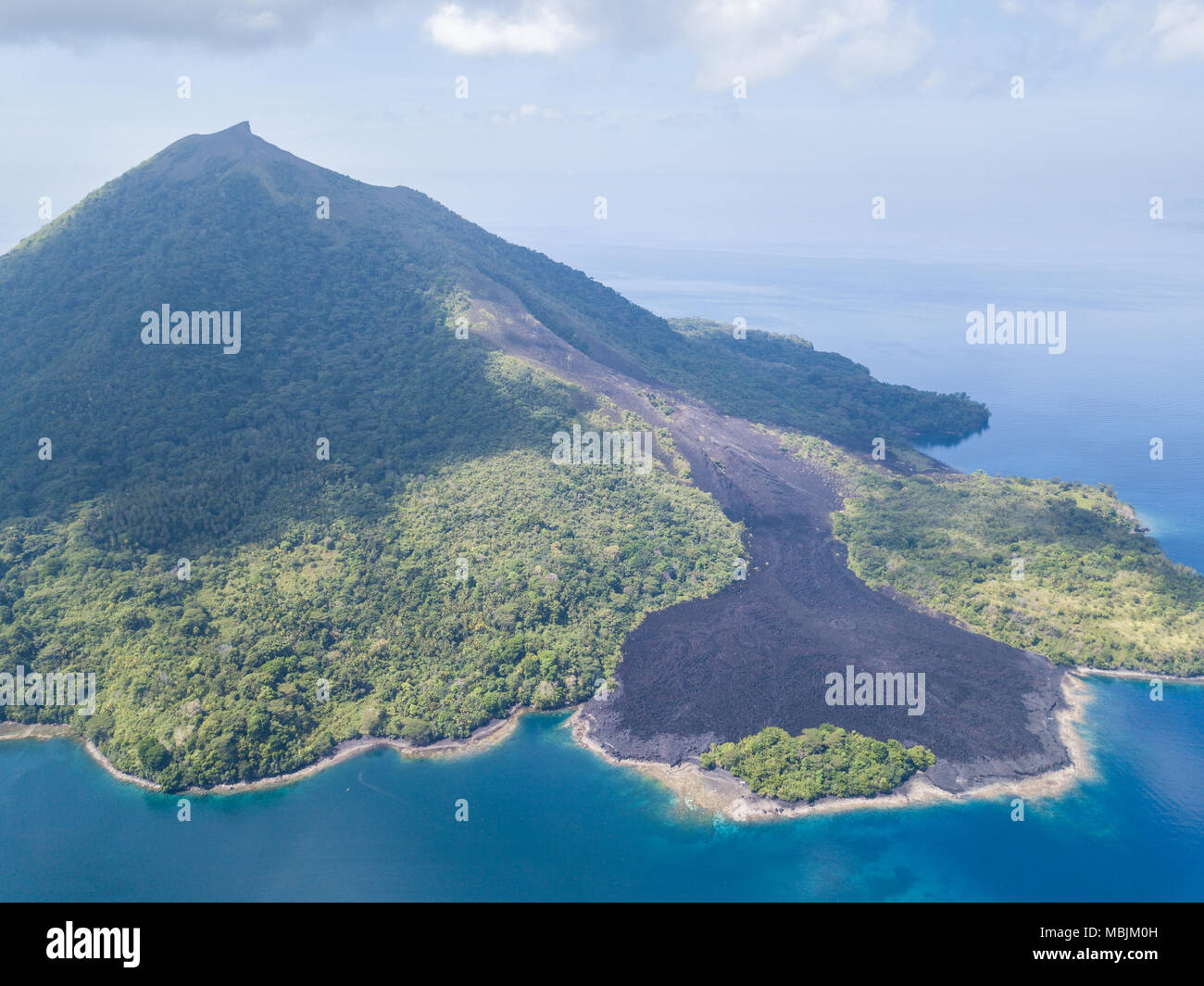A recent lava flow is seen from a birds eye view on Banda Neira in the Banda Sea. This region is in the Coral Triangle and has high biodiversity. - Stock Image