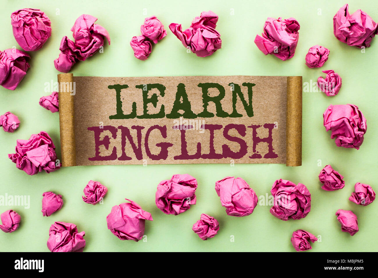 Word writing text Learn English. Business concept for Study another Language Learn Something Foreign Communication written Cardboard Piece the light g - Stock Image