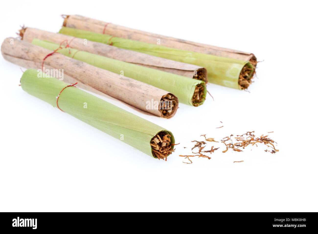 Cigar and tobacco - handmade from dried banana leaf - Stock Image