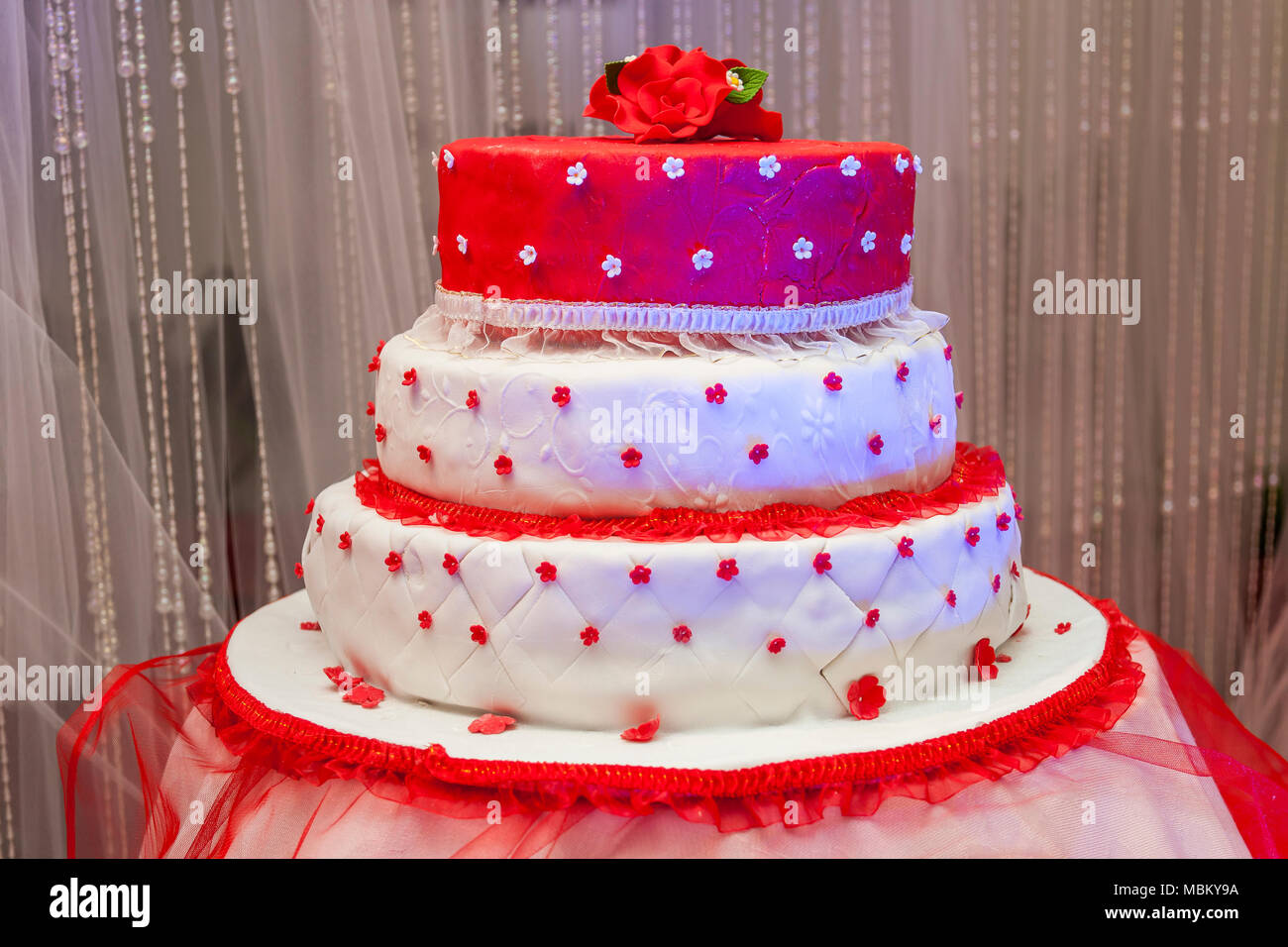 Red and white wedding cake stock photo 179303414 alamy red and white wedding cake junglespirit Gallery