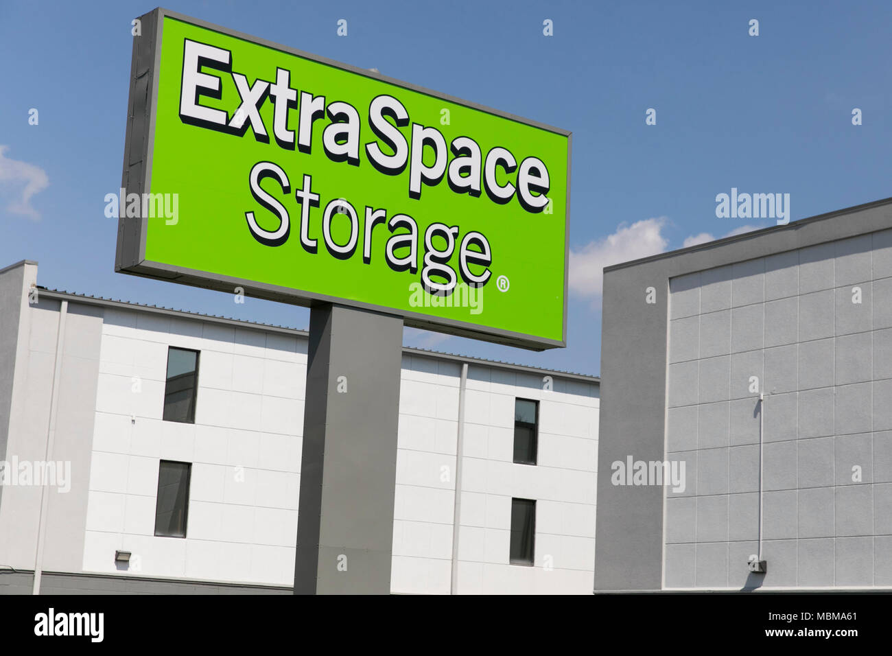 A logo sign outside of a Extra Space Storage location in Wheaton, Maryland on April 10, 2018. - Stock Image