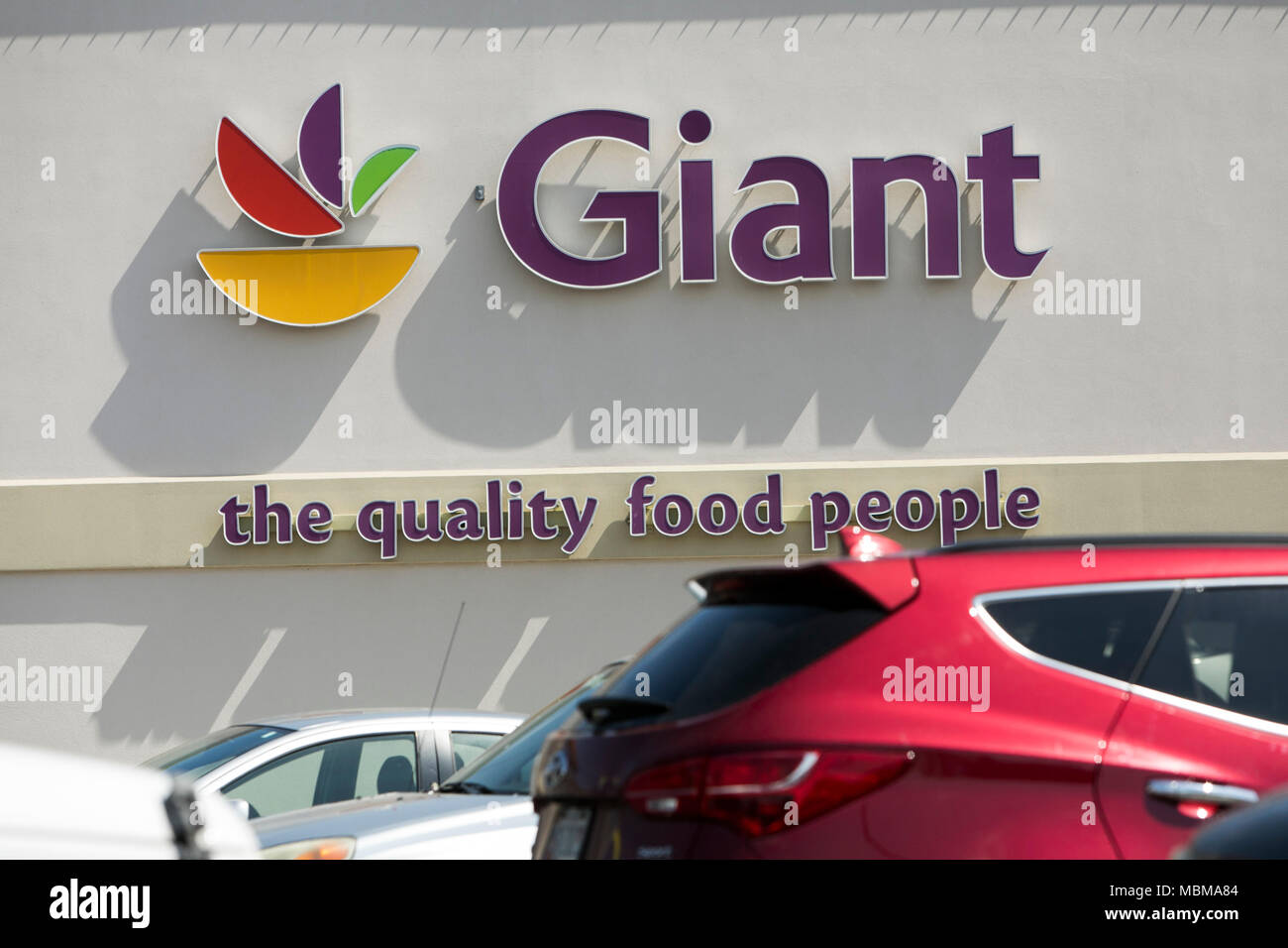 A Logo Sign Outside Of A Giant Food Grocery Retail Store Location In