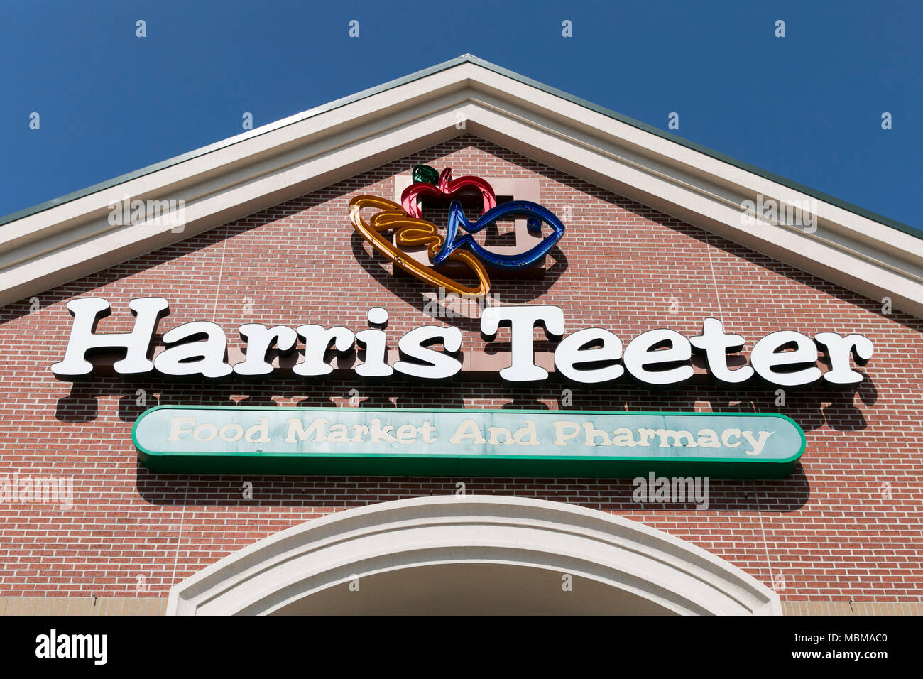 A Logo Sign Outside Of A Harris Teeter Grocery Retail Store Location