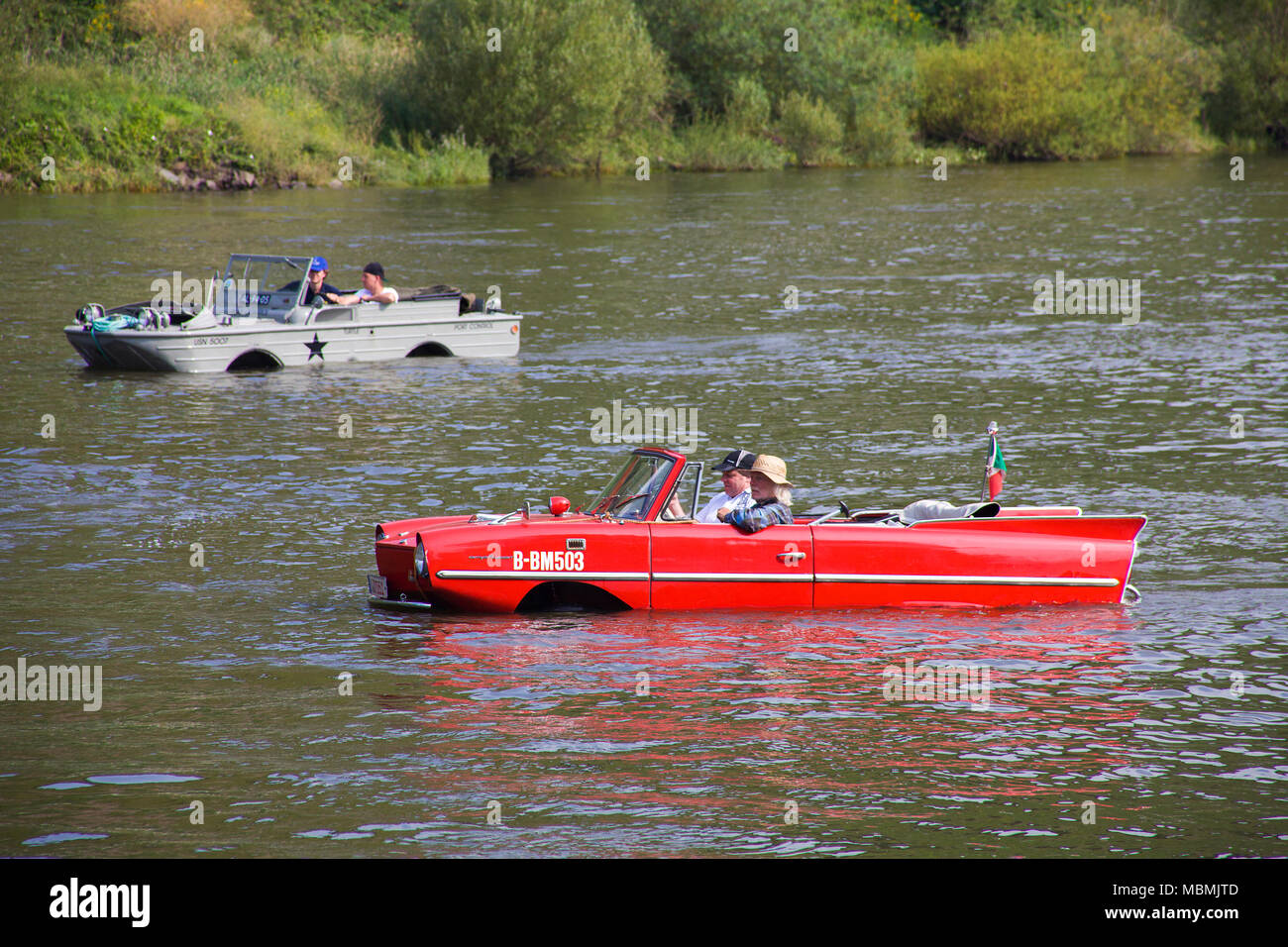 Amphic car and military amphibious vehicle on Moselle river at Cochem, Rhineland-Palatinate, Germany Stock Photo