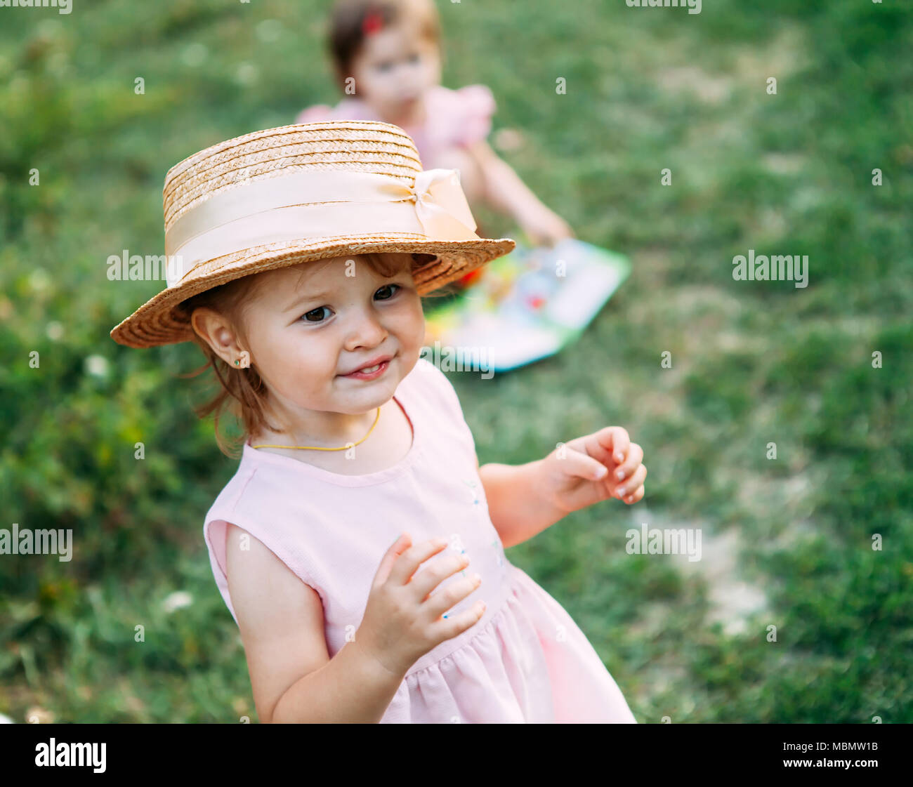 Little Girls Are Playing In Nature Cute Baby Girl Portrait
