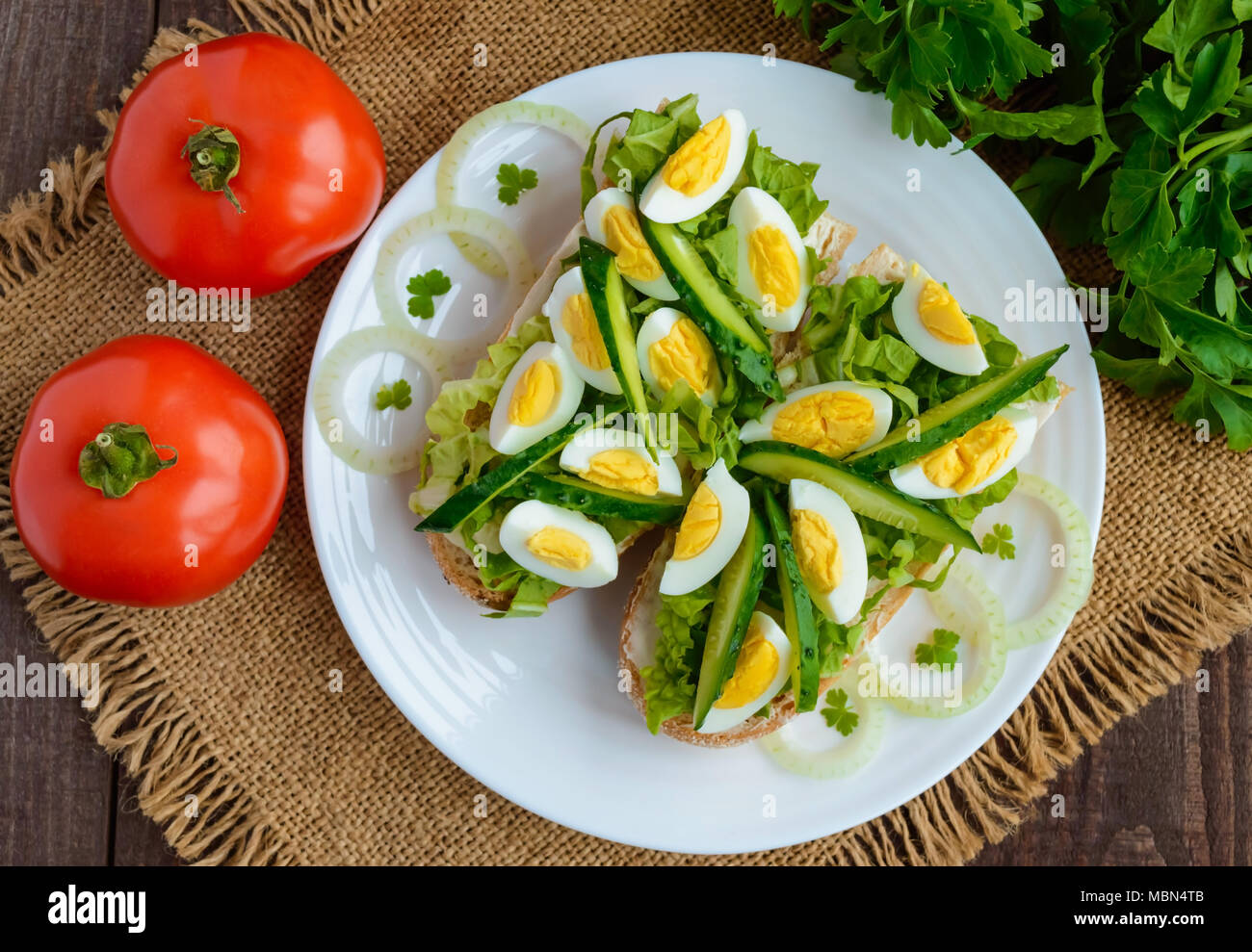 Fresh green sandwich with fresh cucumber, Chinese cabbage, quail egg. Dietary and vegetarian dishes. The top view - Stock Image