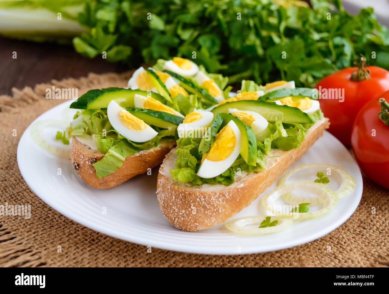 Fresh green sandwich with fresh cucumber, Chinese cabbage, quail egg. Dietary and vegetarian dishes. - Stock Image