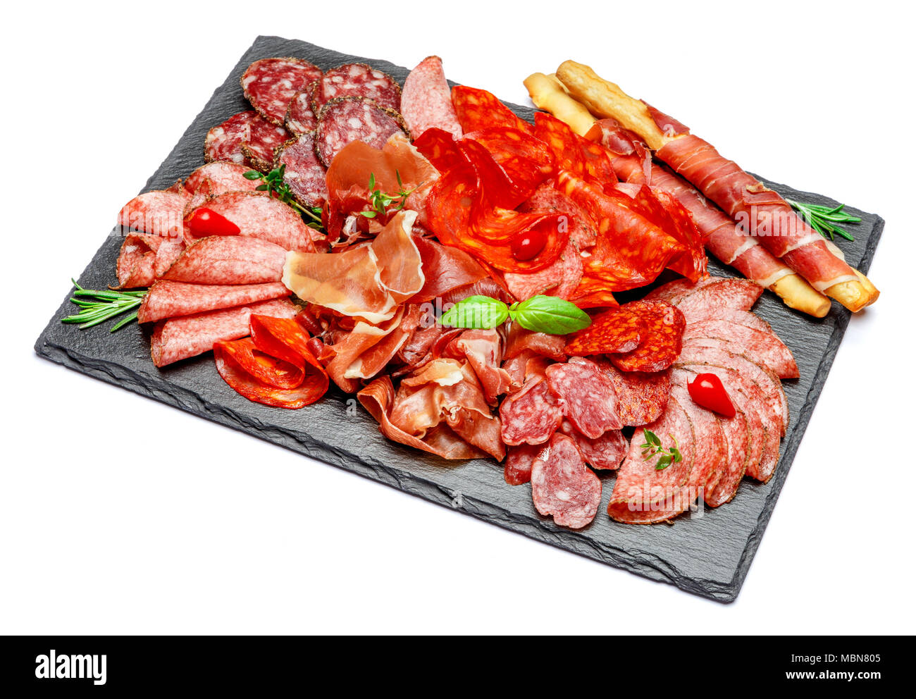 Cold meat plate with salami and chorizo sausage and parma - Stock Image