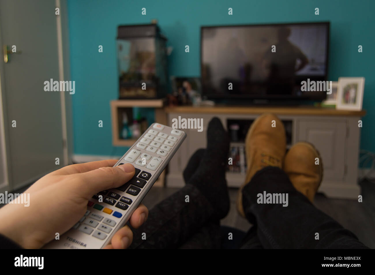 Couple watching television from a first-person perspective - Stock Image