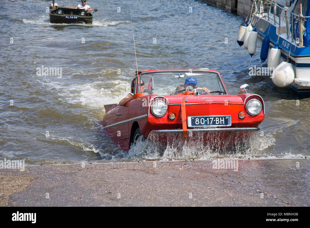 Amphic car, a german amphibious vehicle driving out of water at Moselle river, Cochem, Rhineland-Palatinate, Germany Stock Photo