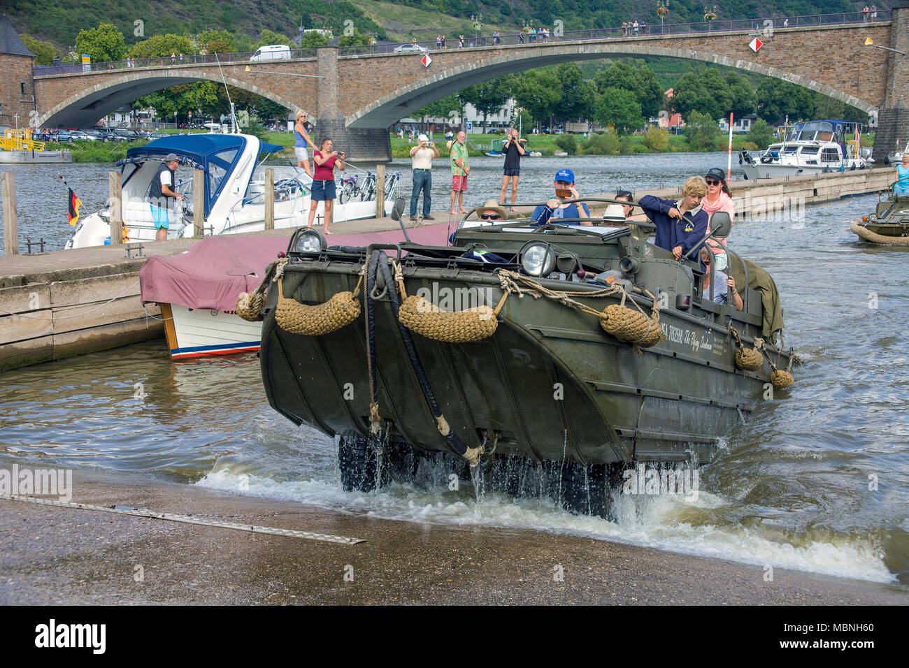 Military amphibious vehicle driving out of water at Moselle river, Cochem, Rhineland-Palatinate, Germany Stock Photo