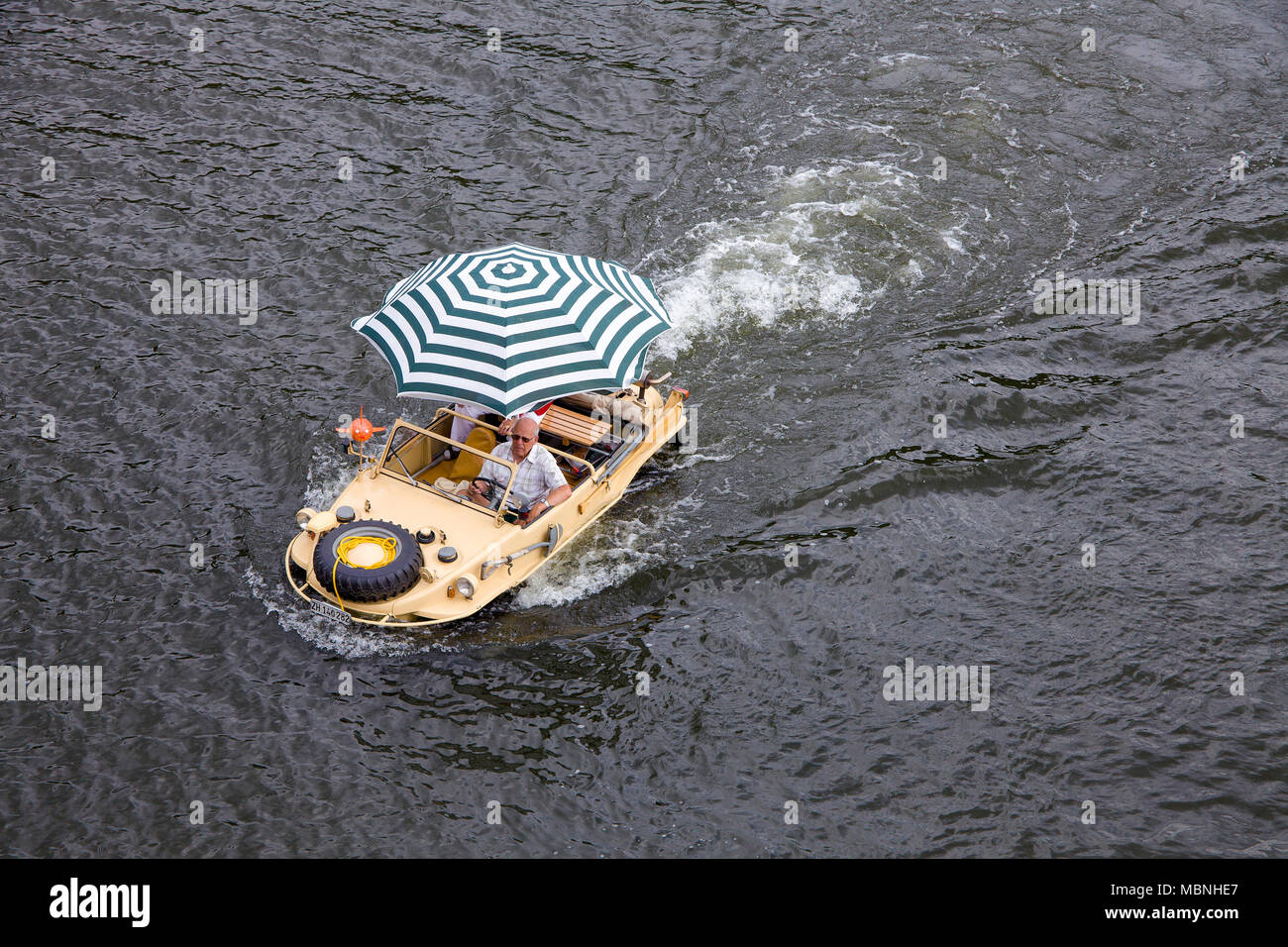 VW Typ 166, a german amphibious vehicle built at the 2nd world war driving on Moselle river, Piesport, Rhineland-Palatinate, Germany - Stock Image