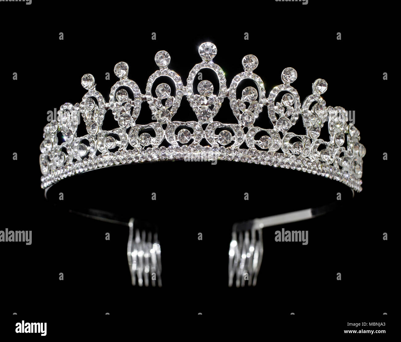Silver tiara diadem with gems and diamonds isolated on black background -  Stock Image 3958c57aeedd
