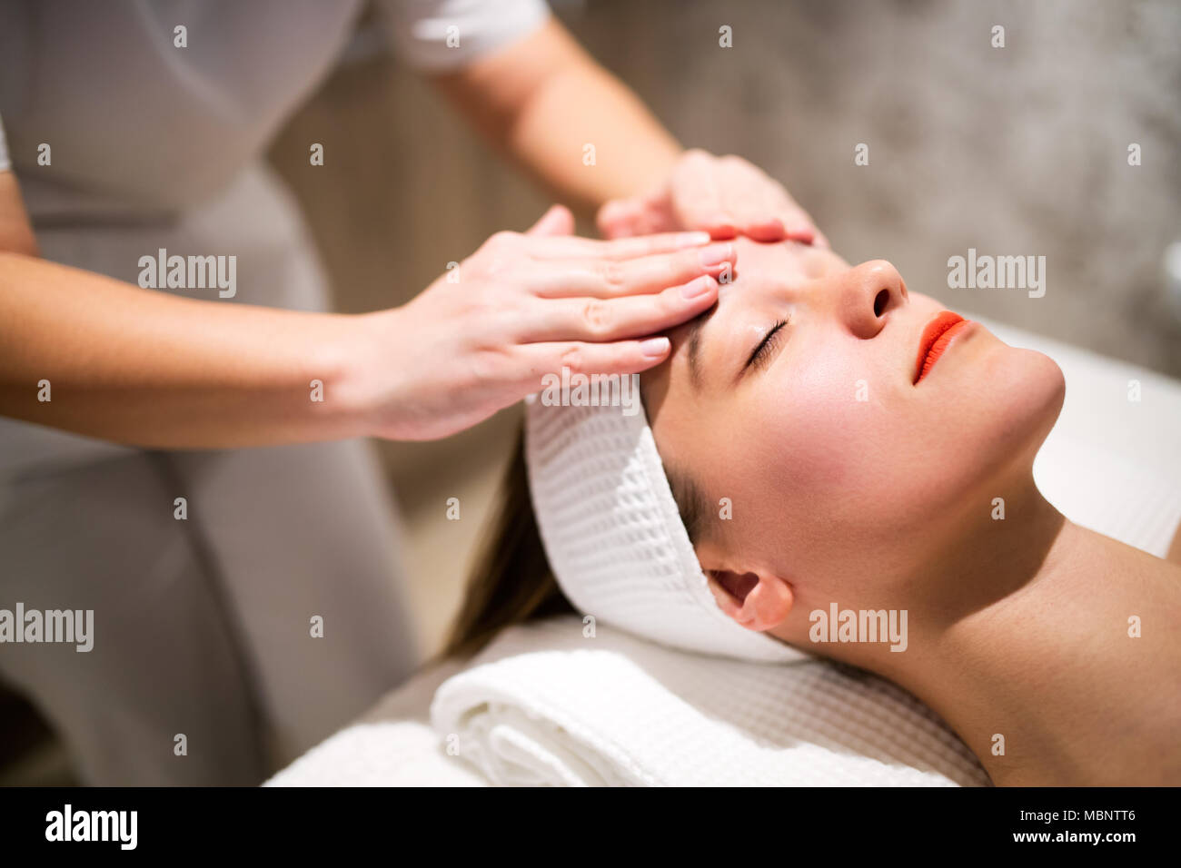 Facial massage treatment by professional - Stock Image