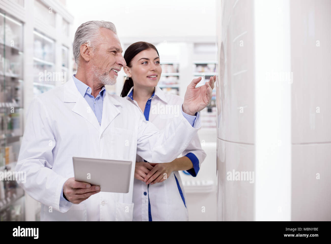 Musing two pharmacists collaborating - Stock Image