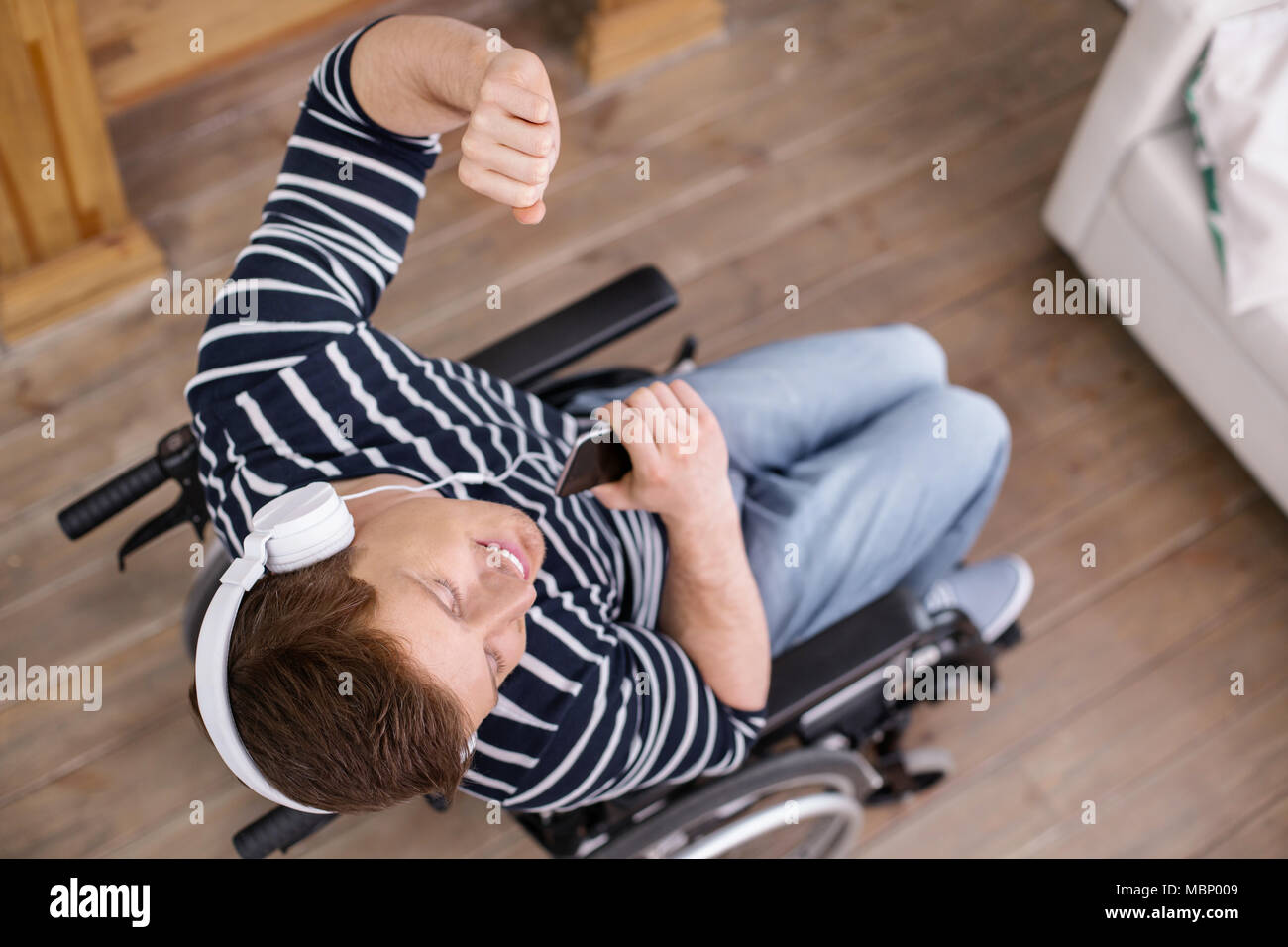 Top view picture of happy man that enjoying his life - Stock Image