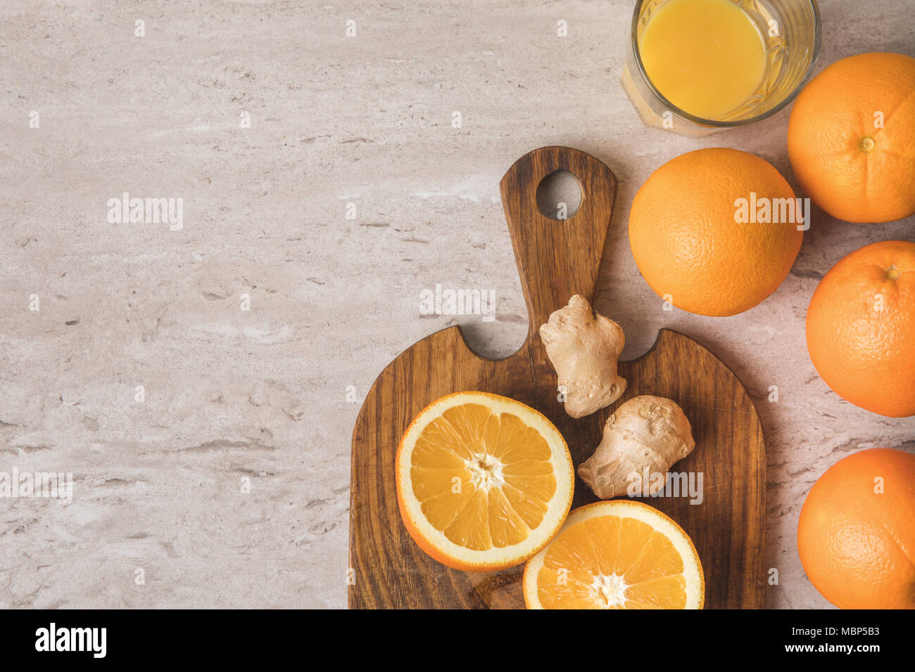top view of oranges and ginger for homemade juice on table - Stock Image