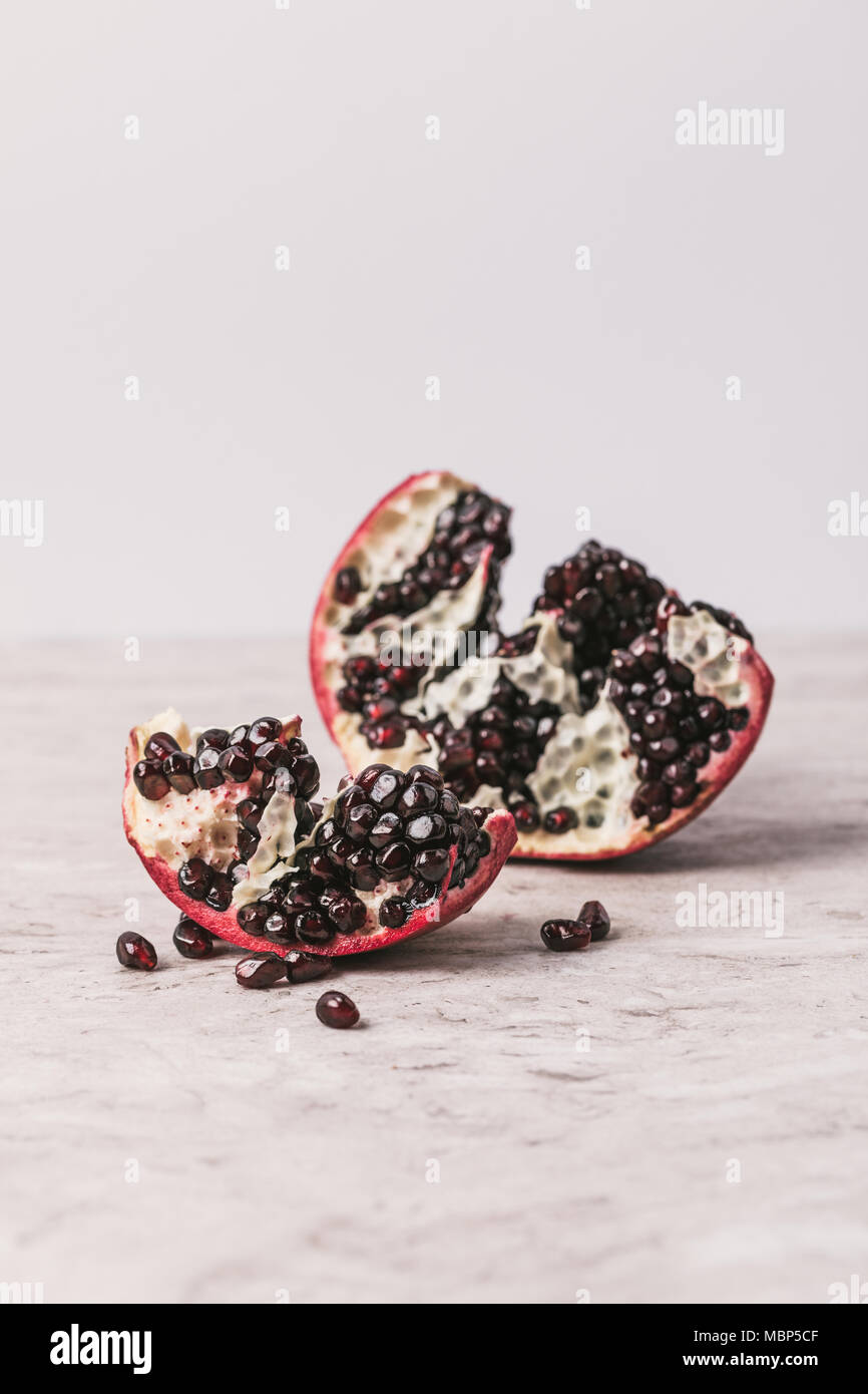 ripe delicious pomegranate on marble table - Stock Image