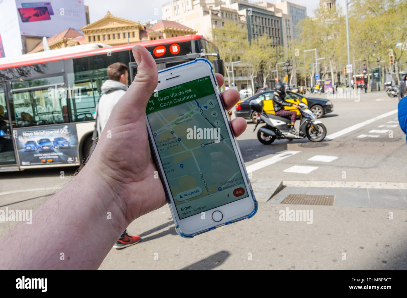 Navigating Barcelona using Google Maps on an iPhone to navigate around the city. - Stock Image