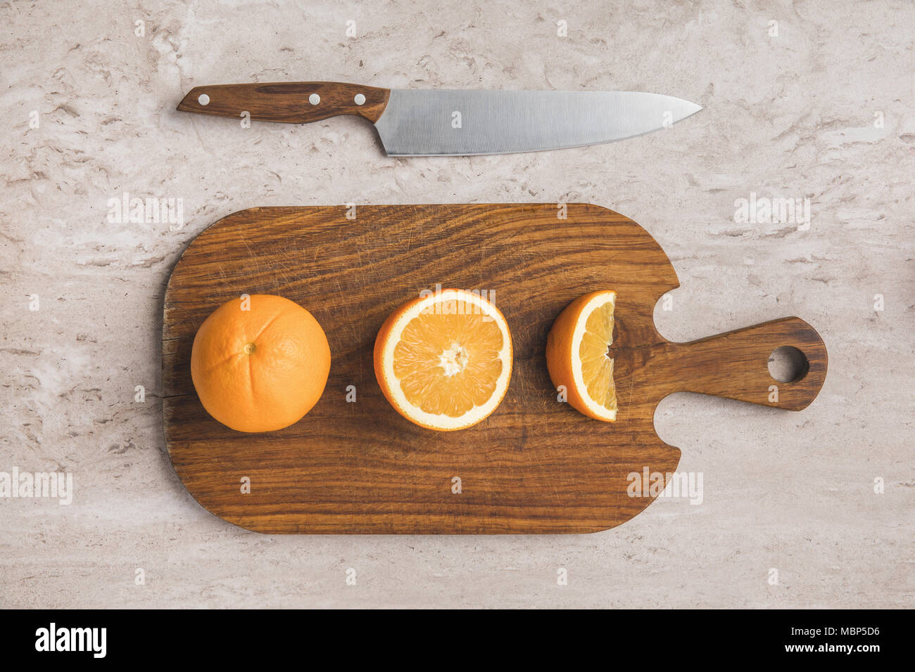 top view of ripe oranges on cutting board  - Stock Image