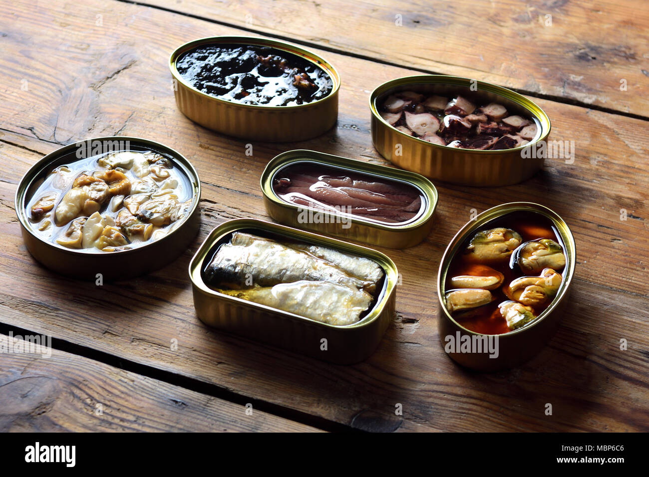 tin cans on a table - Stock Image