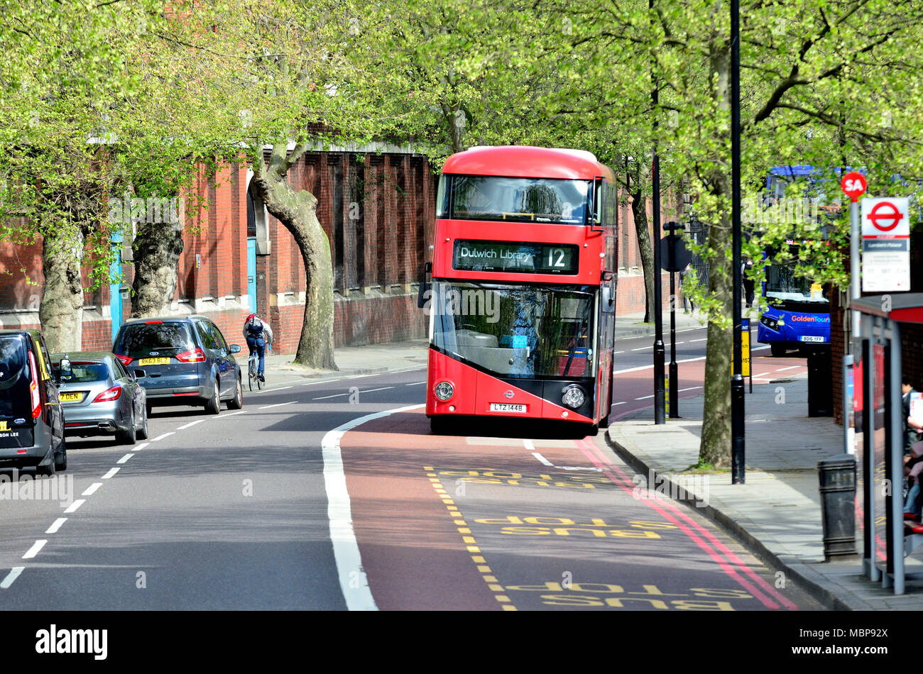 London, England, UK. Red double decker London bus passing Lambeth Palace - Stock Image
