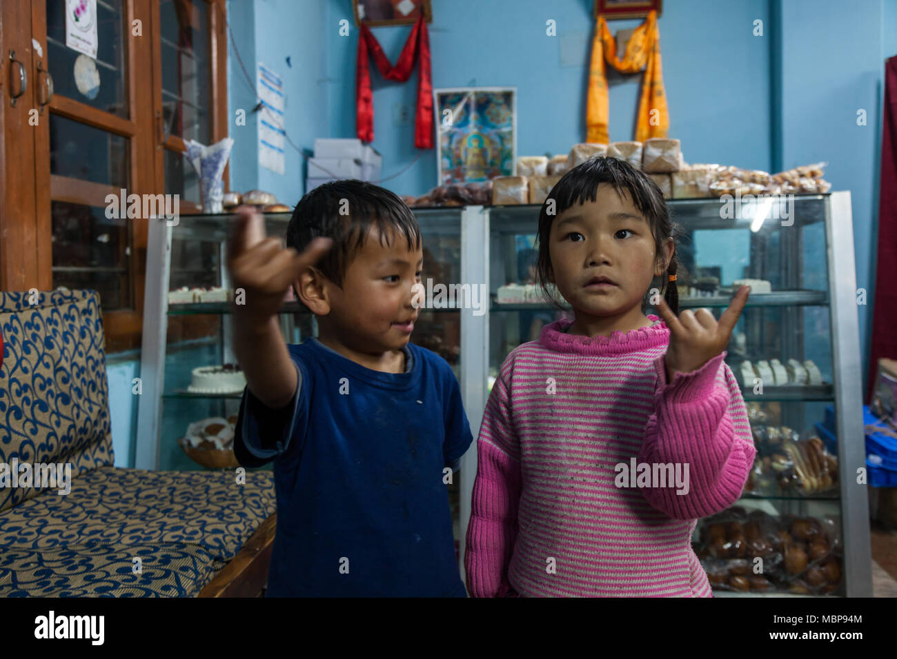 children playing inside house as seen on the road trip to Bhutan in Himalayas - Stock Image