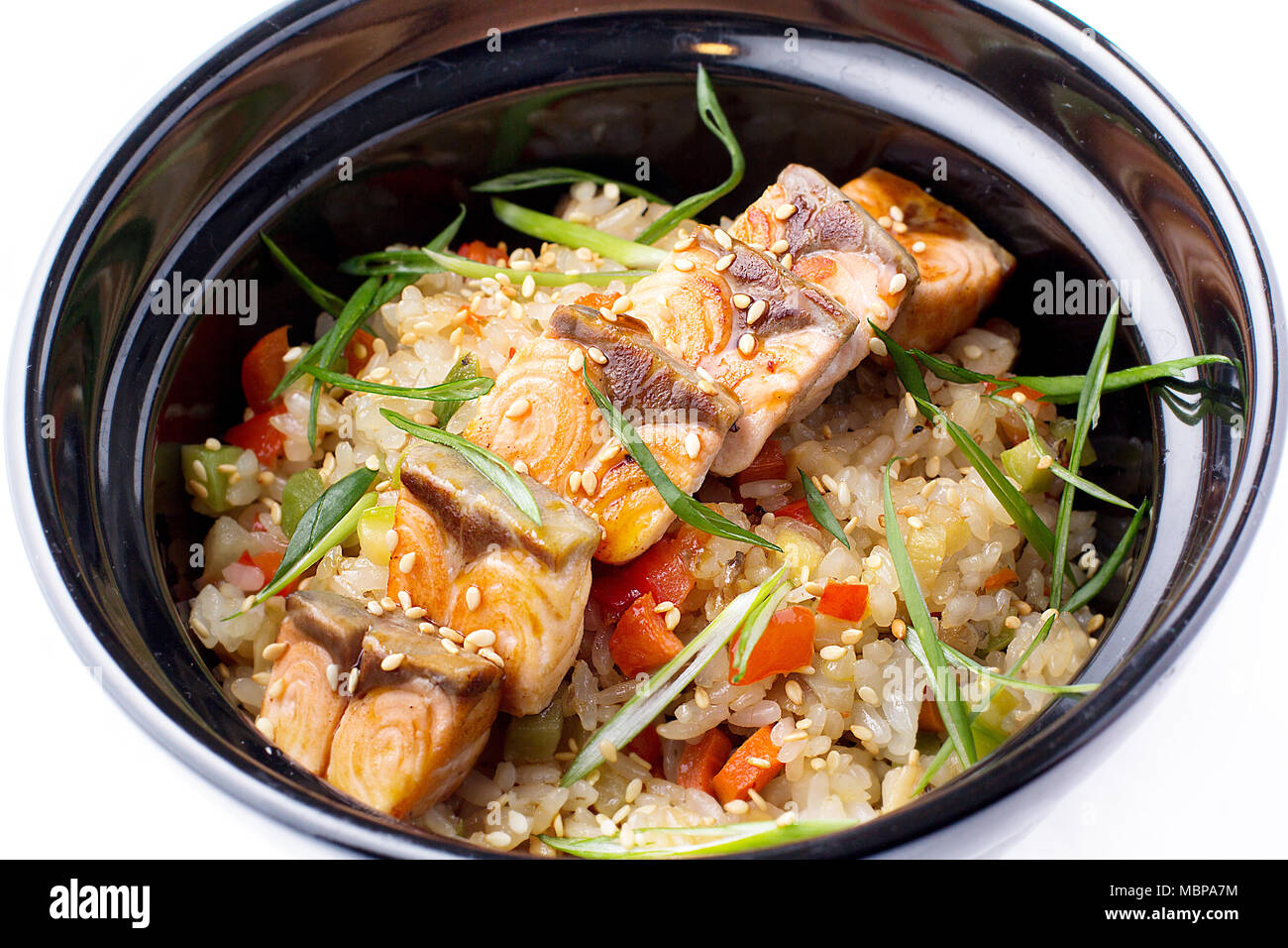 Japanese food rice with vegetables and fried salmon in a black bowl japanese food rice with vegetables and fried salmon in a black bowl japanese food dish isolated on white background rice with fried salmon in teriy forumfinder Choice Image