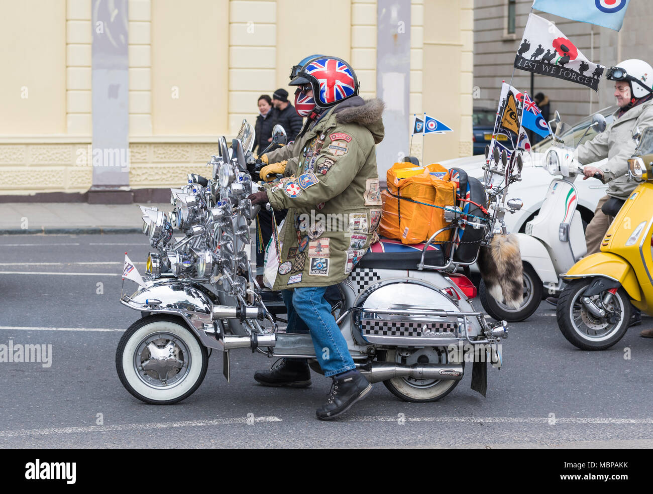 Group of British Mods on decorated motor scooters on a road in Brighton, East Sussex, England, UK. British mods. - Stock Image