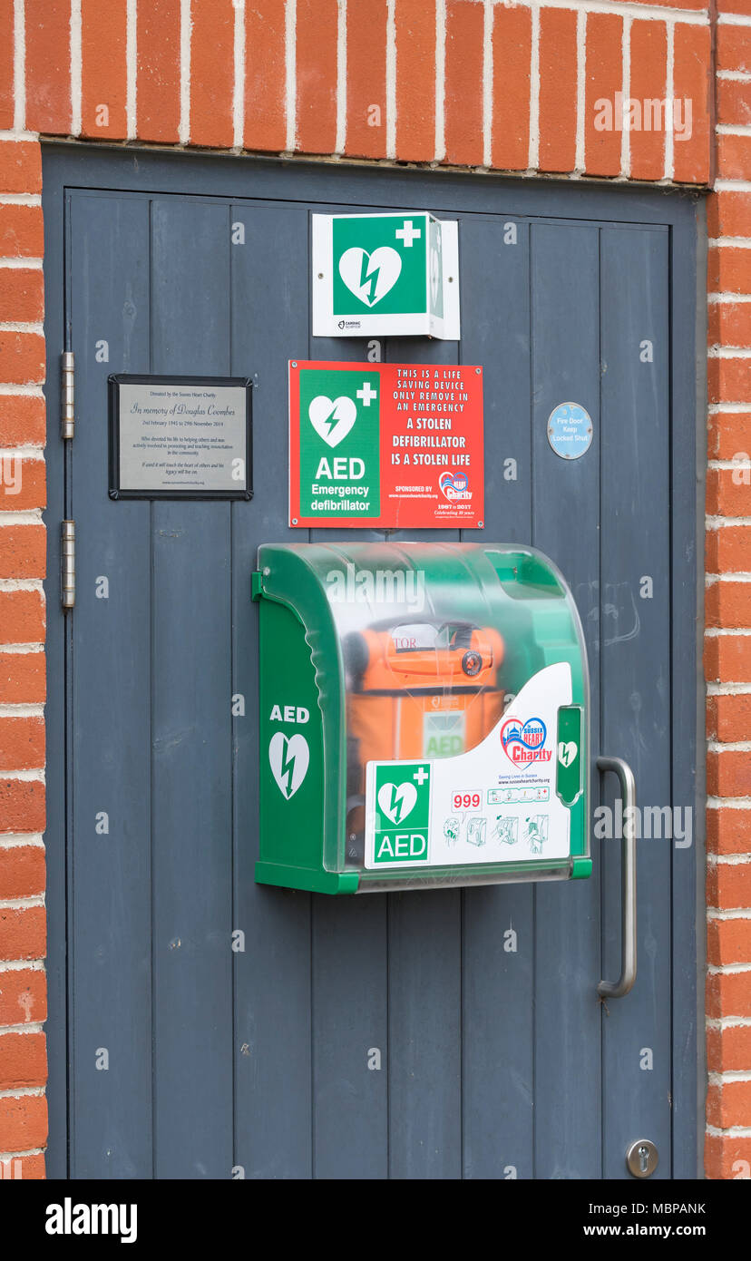 Life saving public access defibrillator machine available to the public in Arundel, West Sussex, England, UK. - Stock Image