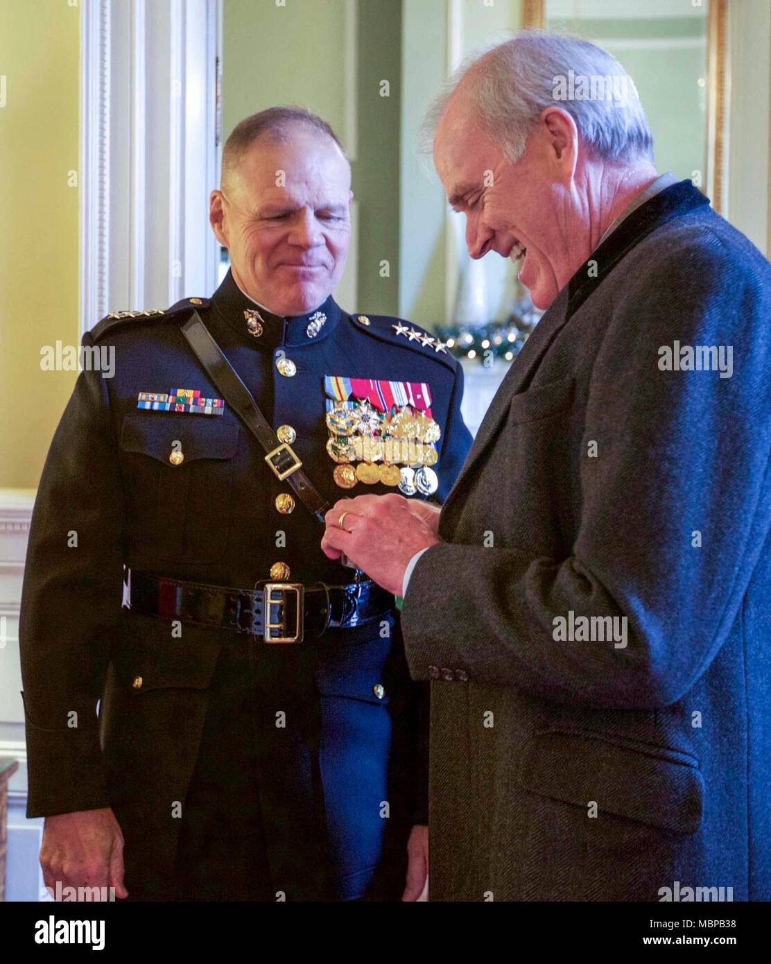 Commandant of the Marine Corps Gen. Robert B. Neller, left, welcomes Secretary of the Navy, Richard V. Spencer before the 2018 Surprise Serenade at the Home of the Commandants, Washington, D.C., Jan. 1, 2018. The Surprise Serenade is a tradition that dates back to the mid-1800's in which the U.S. Marine Band performs music for the Commandant of the Marine Corps at his home on New Years Day. (U.S. Marine Corps photo by Sgt. Olivia G. Ortiz) Stock Photo