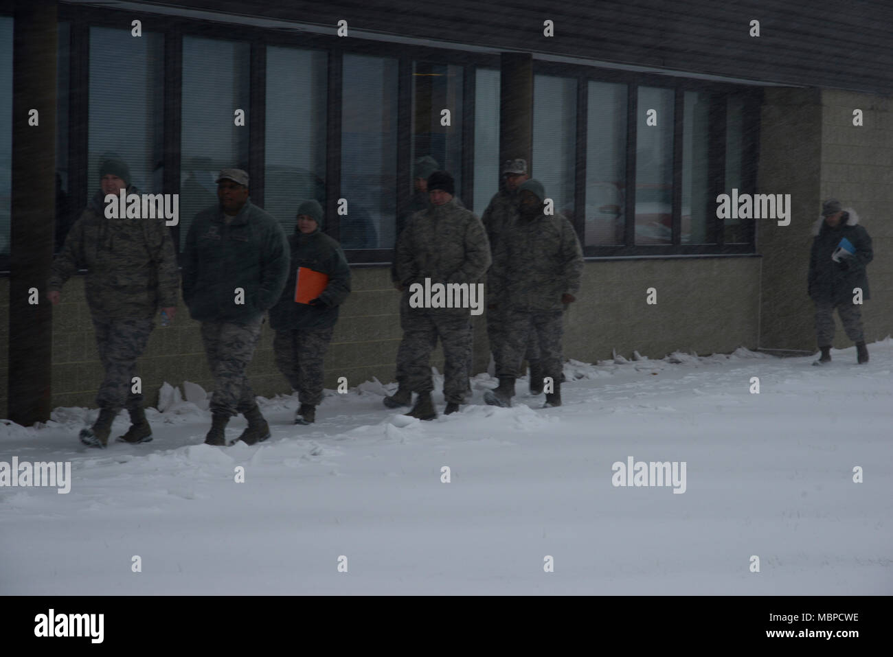 More than a dozen Airmen, assigned to the 105th Airlift Wing, gather cold weather gear and prepare to respond to heavy snow and wind at Stewart Air National Guard Base Jan. 4, 2017. The Airmen are tasked as part of New York state's Initial Response Force to help local officials mitigate the destruction of such weather events. (U.S. Air Force photo by Staff Sgt. Julio A. Olivencia Jr.) Stock Photo