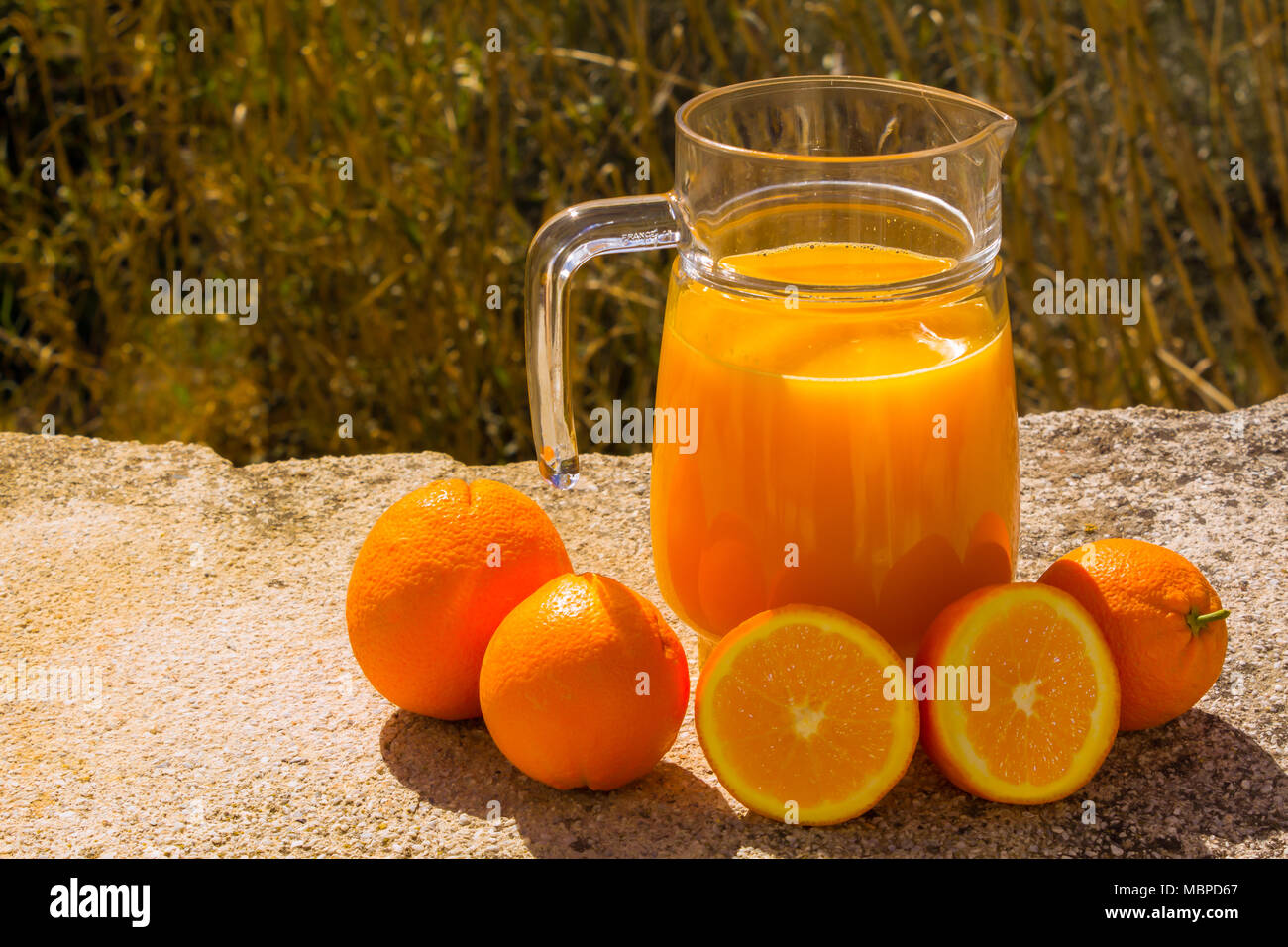Pitcher of Freshly squeezed Orange Juice, with fresh Oranges, Outside with a Natural Backdrop, March 2018, Almeria Andalucia Spain. - Stock Image