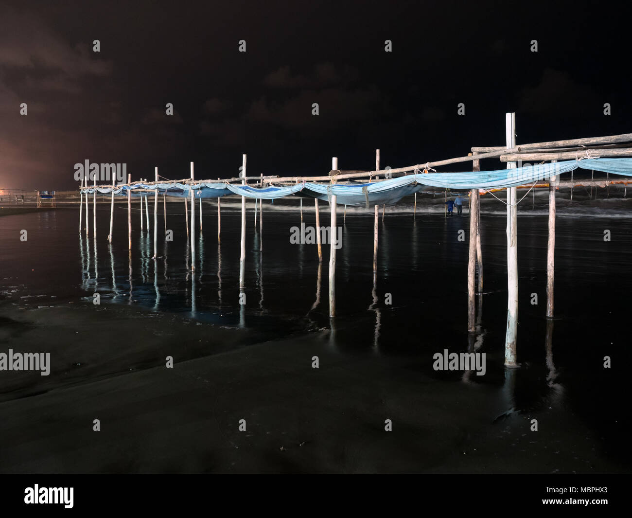 Night view of wooden structure used to separate women from men in the Caspian sea, according to islamic rules. Babolsar, Iran - Stock Image