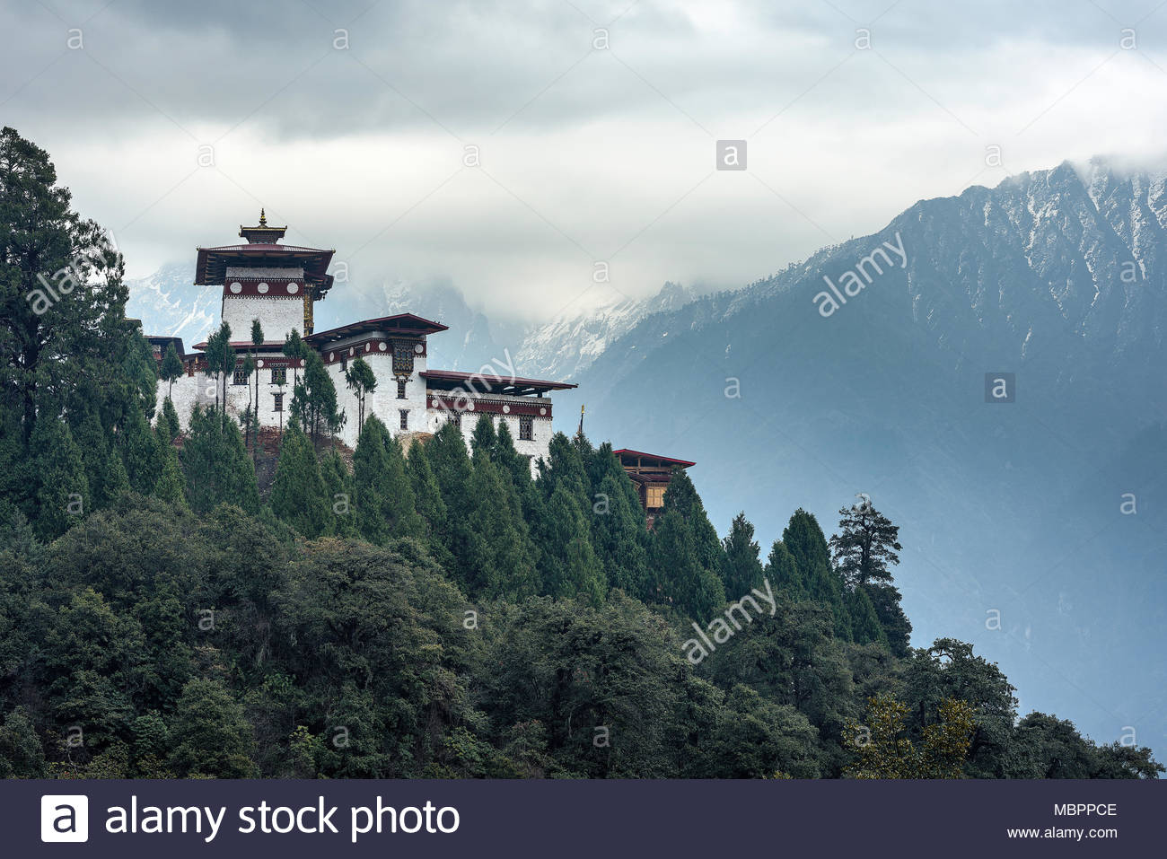 View of the remote Gasa Dzong on a cloudy day in March, Bhutan. The monastery is famous for it's architecture and festivals (tcheshu). Stock Photo