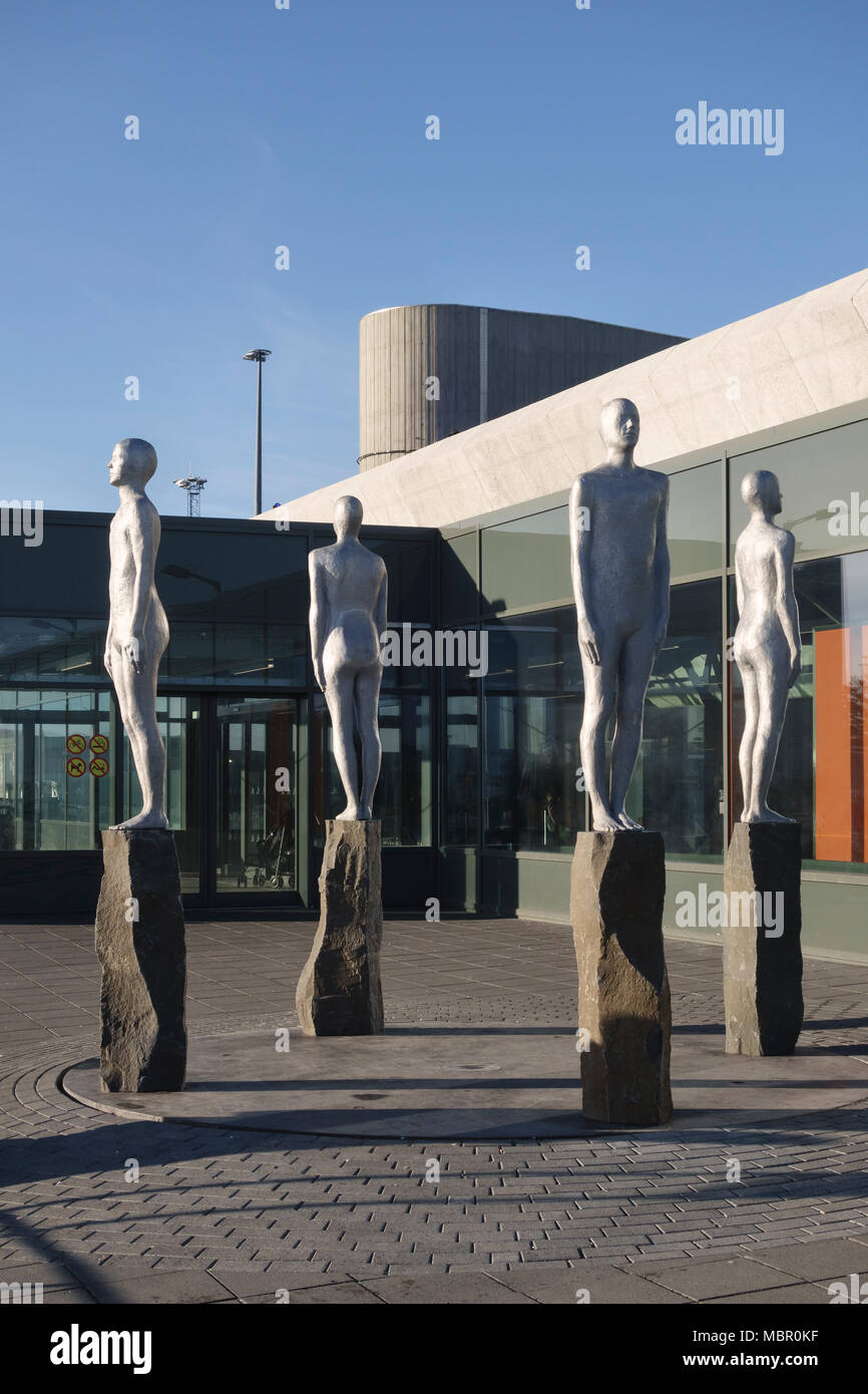 Keflavik Airport, Reykjavik, Iceland. Directions, a sculpture by Steinunn Thorarinsdottir, stands outside the main terminal building - Stock Image