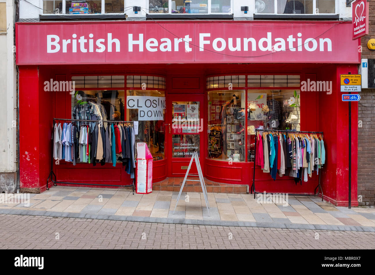 The closing down British Heart Foundation charity shop in Congleton Cheshire UK - Stock Image