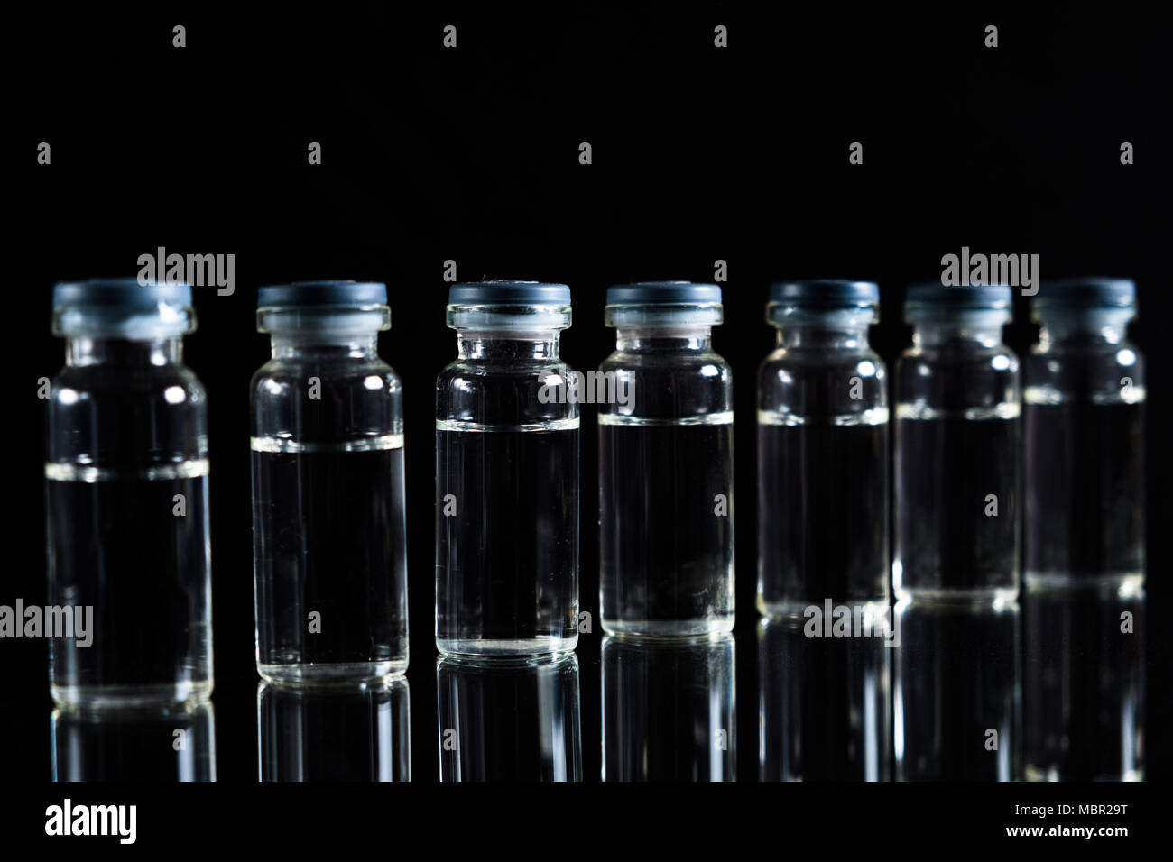 Vaccines and syringes with a copy of space - Stock Image