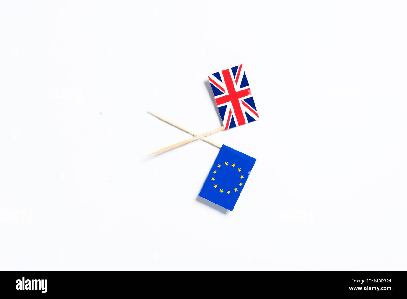 A Union Jack flag and a European Union flag on a white background - Stock Image