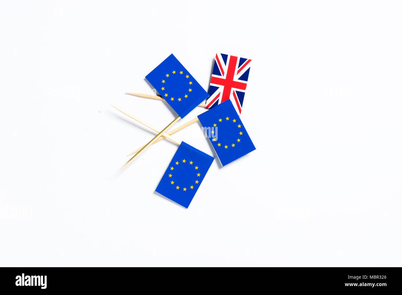 One Union Jack flag and three European Union flags on a white background - Stock Image